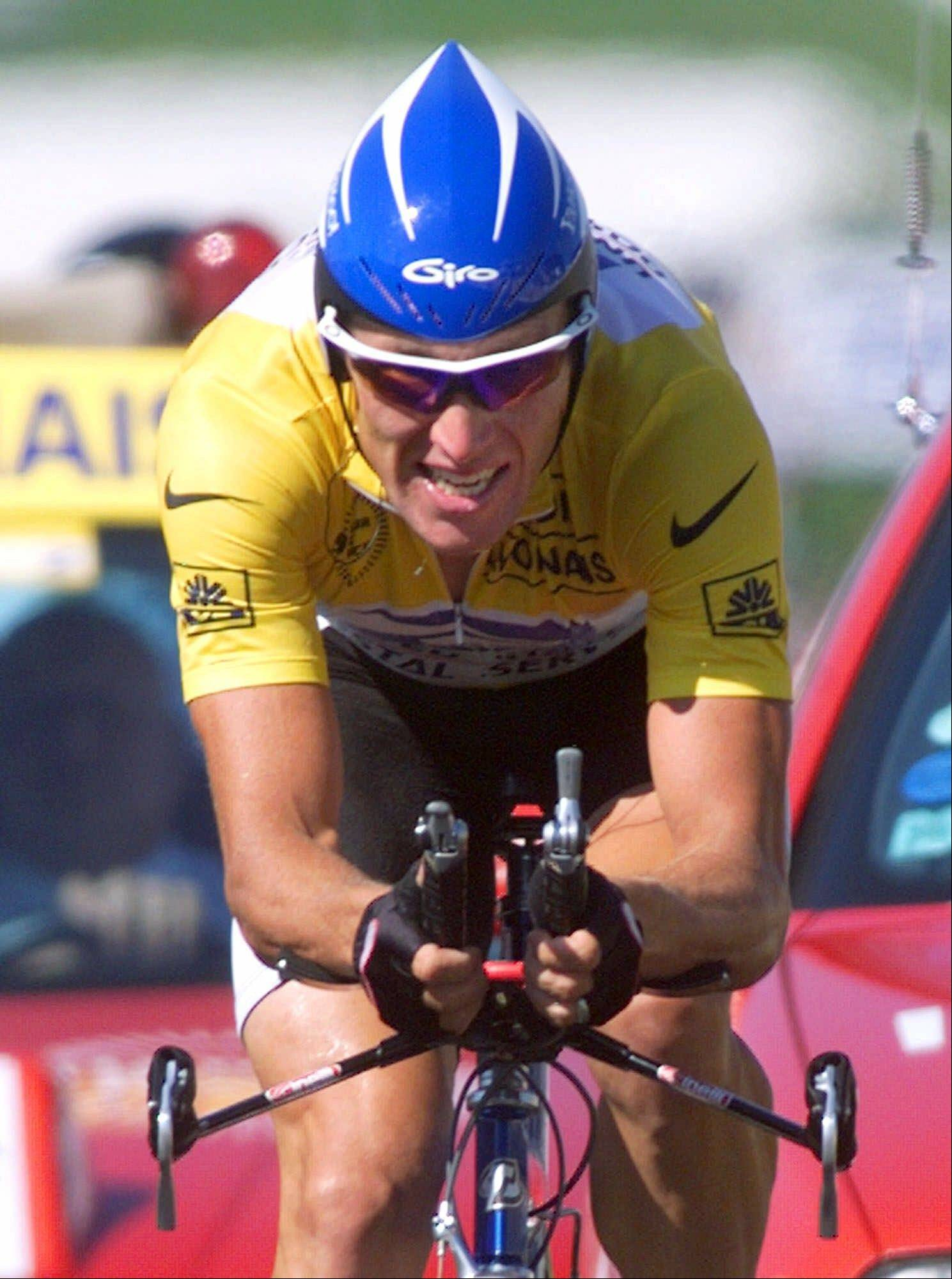 Overall leader Lance Armstrong strains on his way to winning the 19th stage of the Tour de France in 1999.
