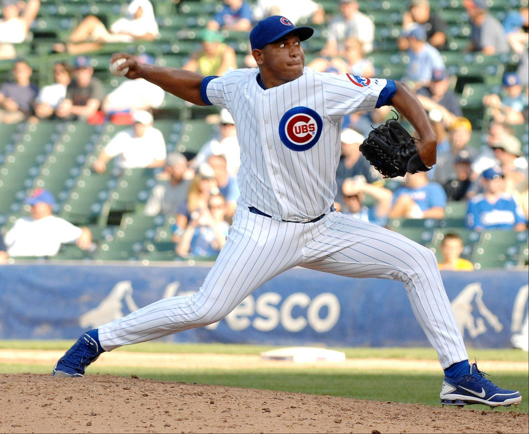 Chicago Cubs relief pitcher Carlos Marmol delivers a pitch in the top of the ninth.