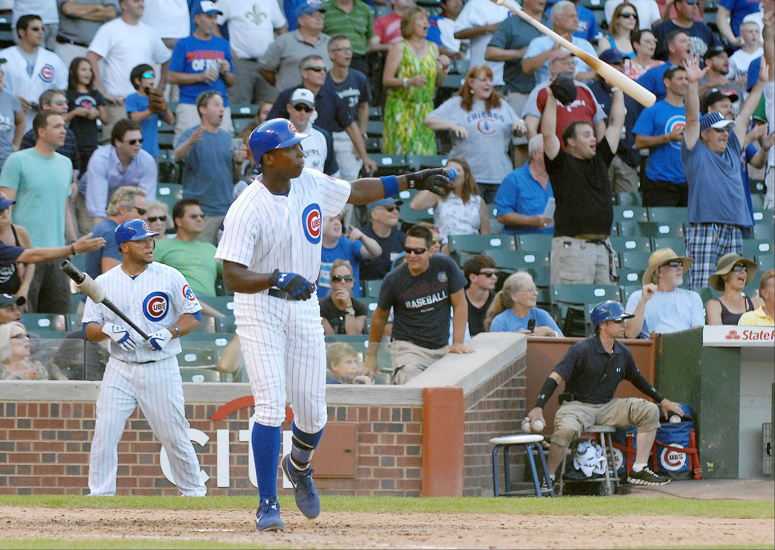 Alfonso Soriano tosses his bat after his game-winning hit.