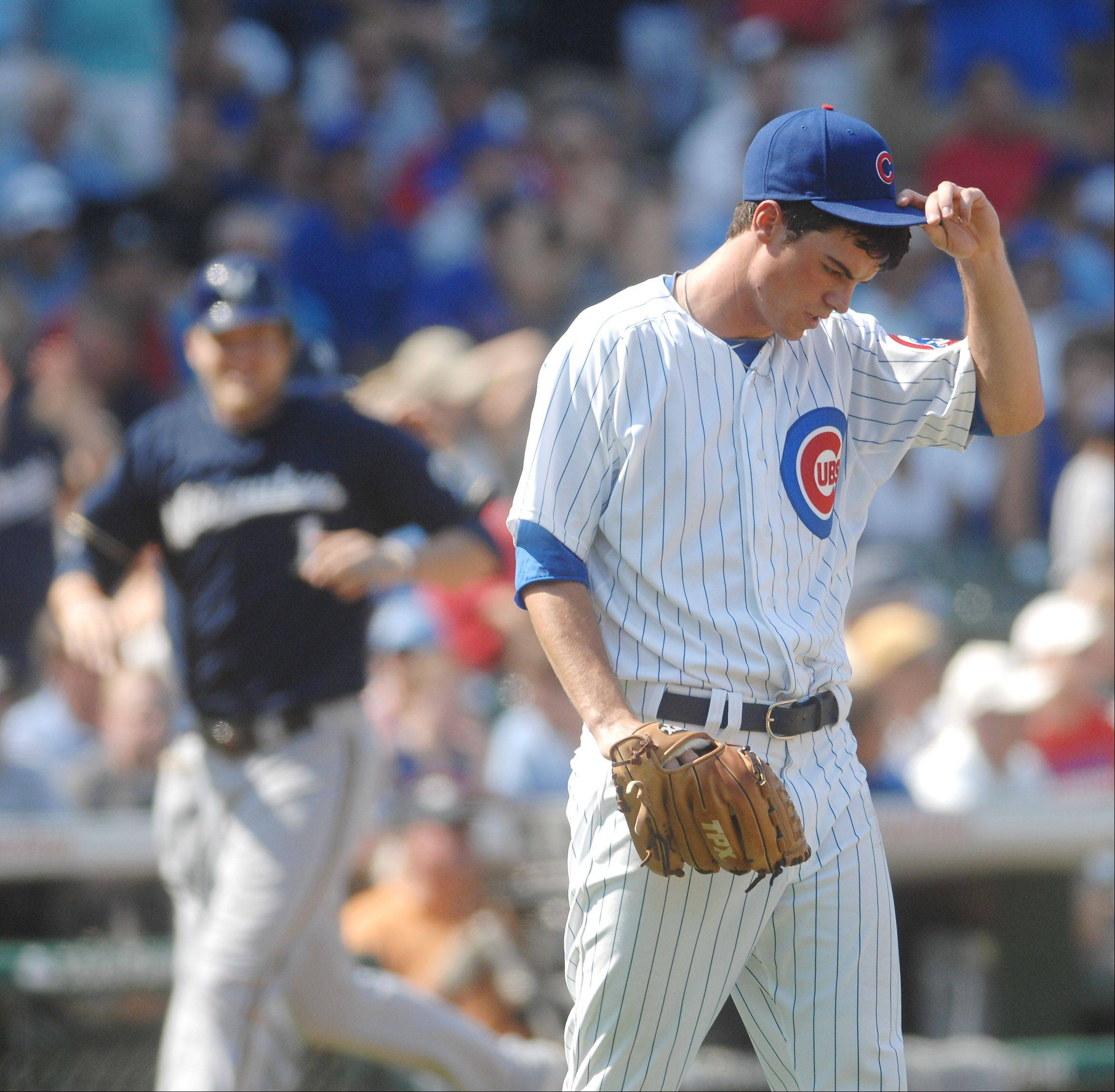 Chicago Cubs starting pitcher Brooks Raley composes himself after giving up a third-inning grand slam .