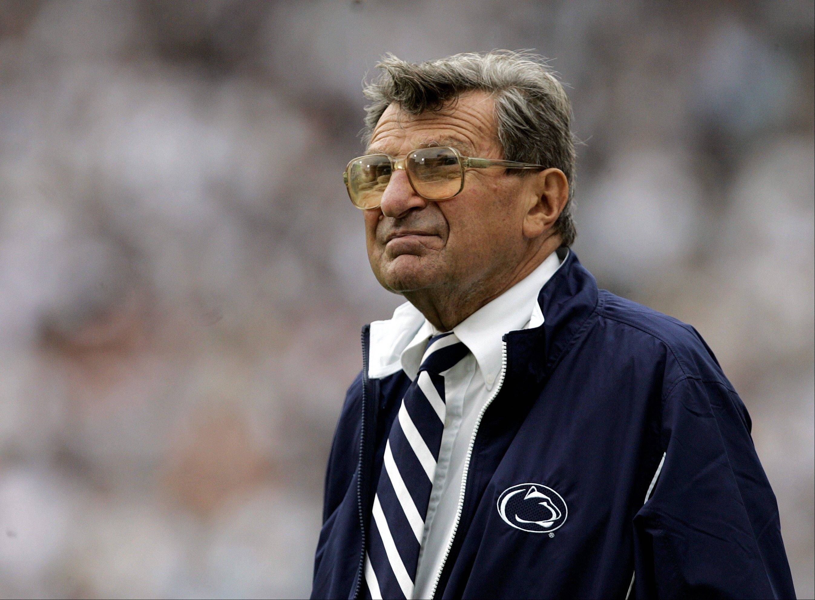 Penn State coach Joe Paterno watches a 2006 game against Youngstown State from the sidelines in State College, Pa. Paterno died of cancer in January 2012, just months after losing his job in the wake of the Jerry Sandusky sex abuse scandal.
