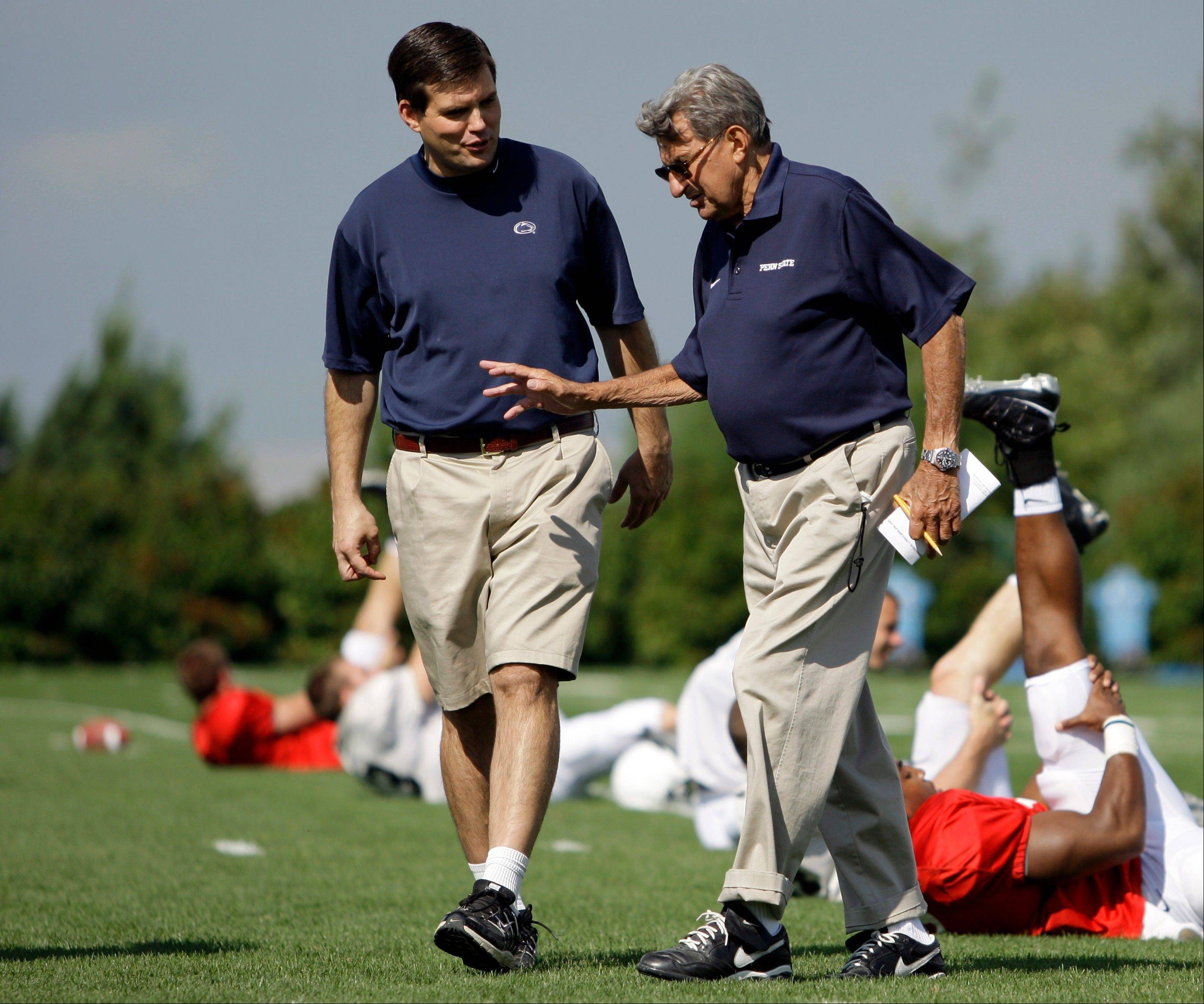 Penn State football coach Joe Paterno, right, walks with his son Jay Paterno, who was the team's quarterbacks coach, as players stretch out during a 2008 practice in State College, Pa. A new era is dawning at Penn State, with a new football coach and a new look to the uniforms. But no Paterno on the sideline in a season opener for the first time since 1965.