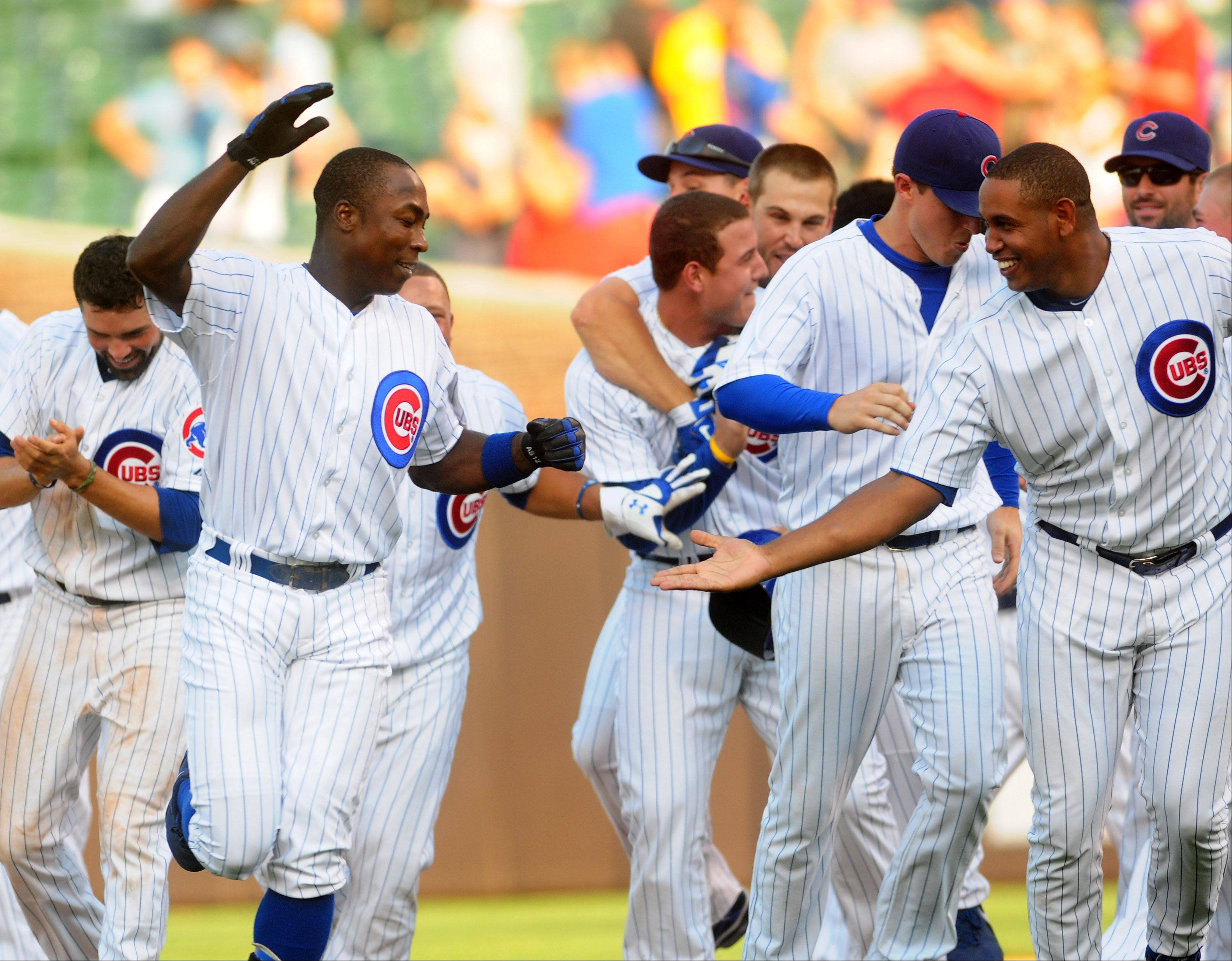 Alfonso Soriano celebrates after his game-winning hit Thursday against the Milwaukee Brewers.