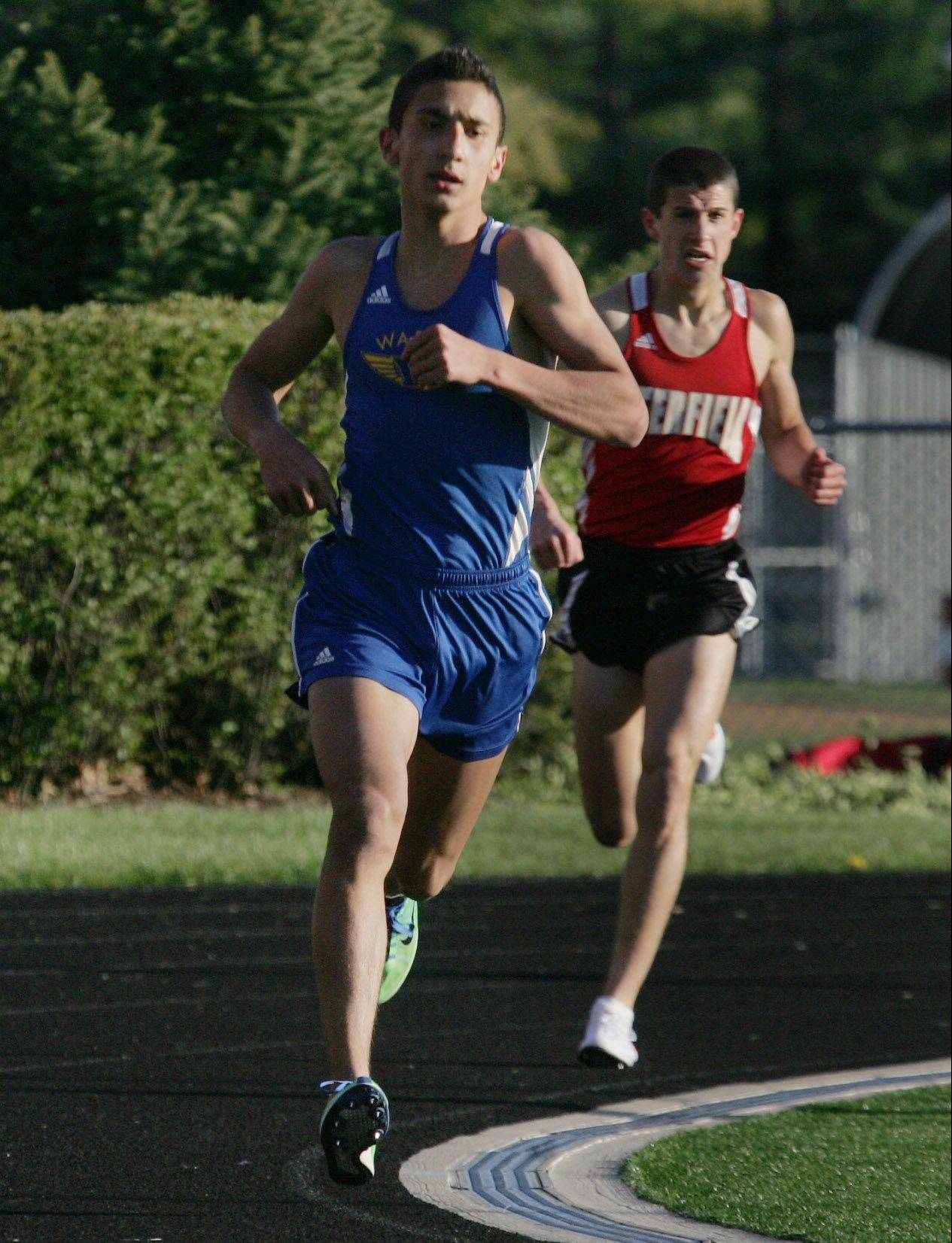 Warren's Martin Martinez heads for victory in the 3,200 meters at Grant High School last spring.