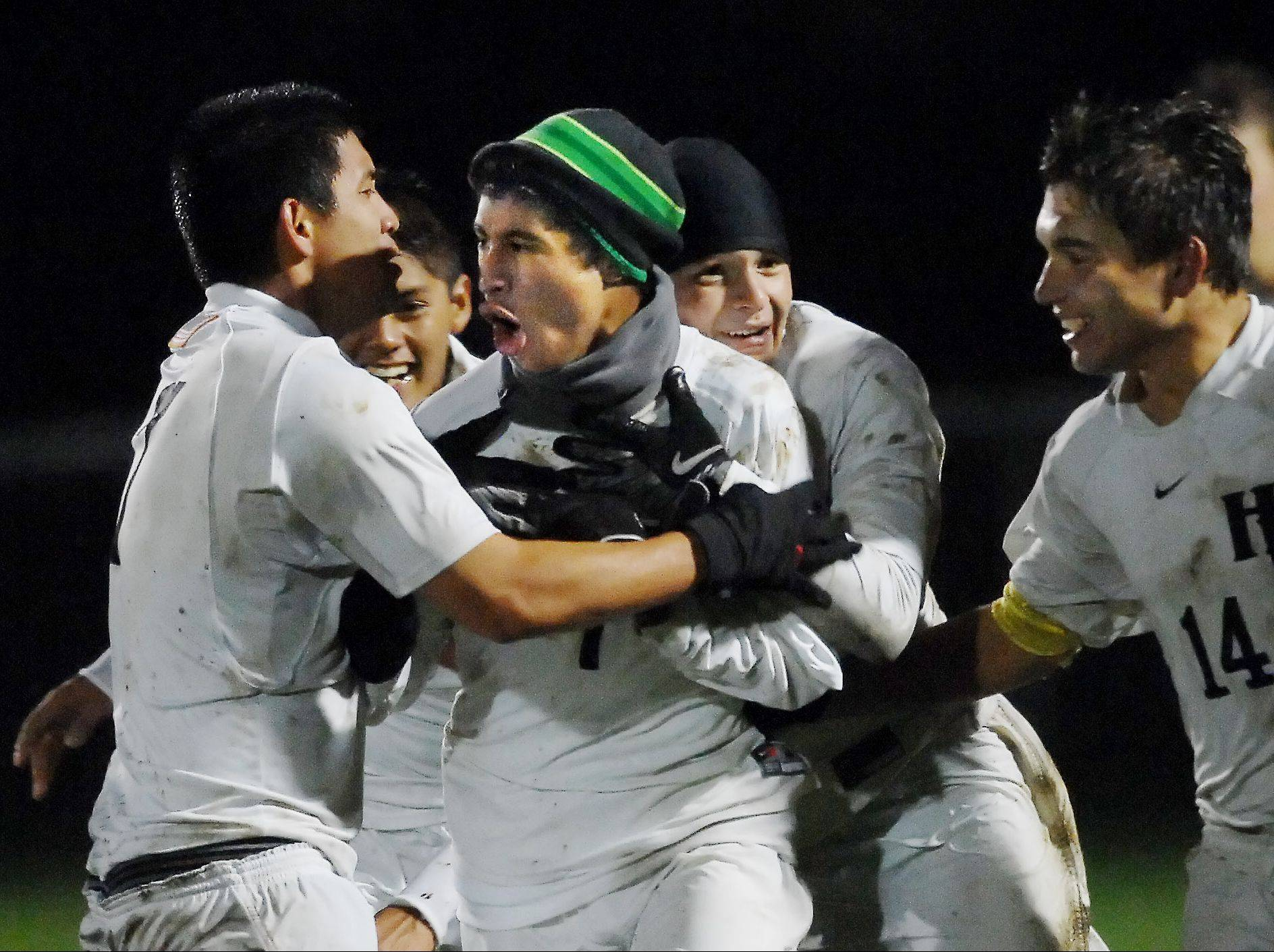 Jacobs' Eric Soto is hugged by teammates after he scored a goal against Huntley last season. Soto is a senior and among the top returners for the Golden Eagles, who feature a roster with plenty of experience.