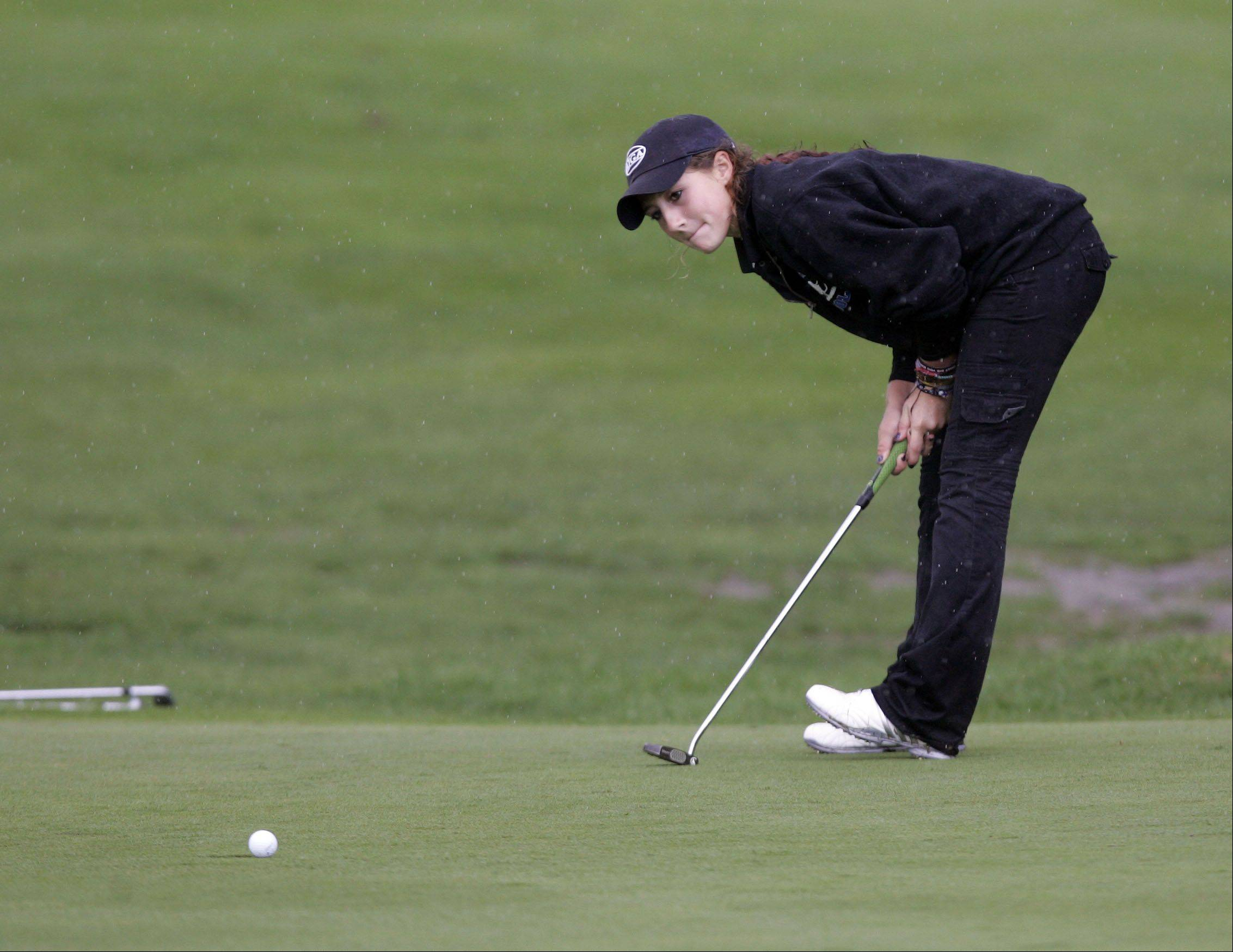 Brian Hill/bhill@dailyherald.com � St. Charles North's Ariana Furrie watches her putt on the 15th green during the Upstate Eight Conference IHSA girls golf tournament at St. Andrews Golf Club in West Chicago Tuesday, September 27, 2011. group 1 �