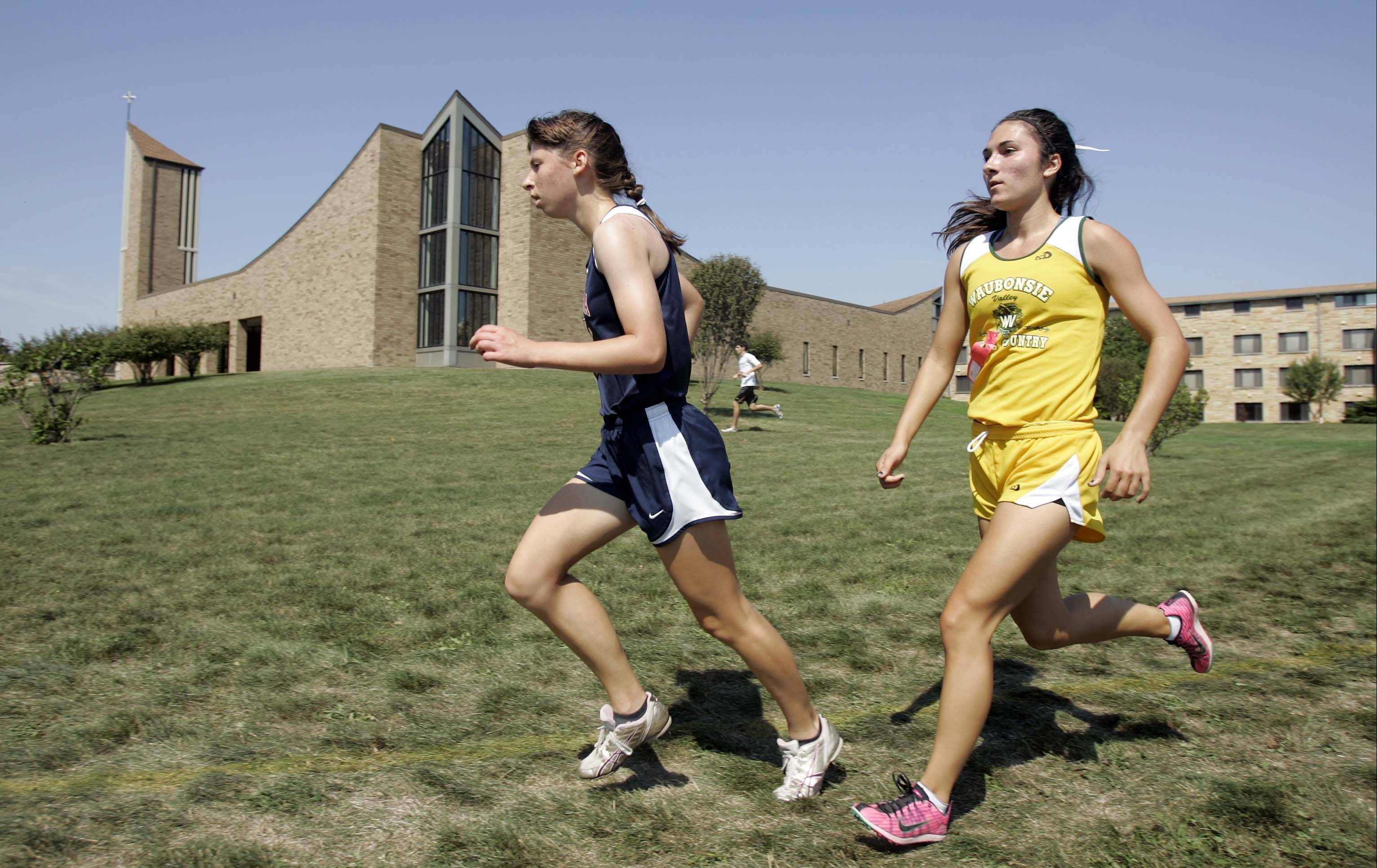 West Aurora's Miranda Gollwitzer, left, came in second behind Waubonsie Valley's Ashley Bruner, right, Saturday at the Aurora City Meet at Marmion.