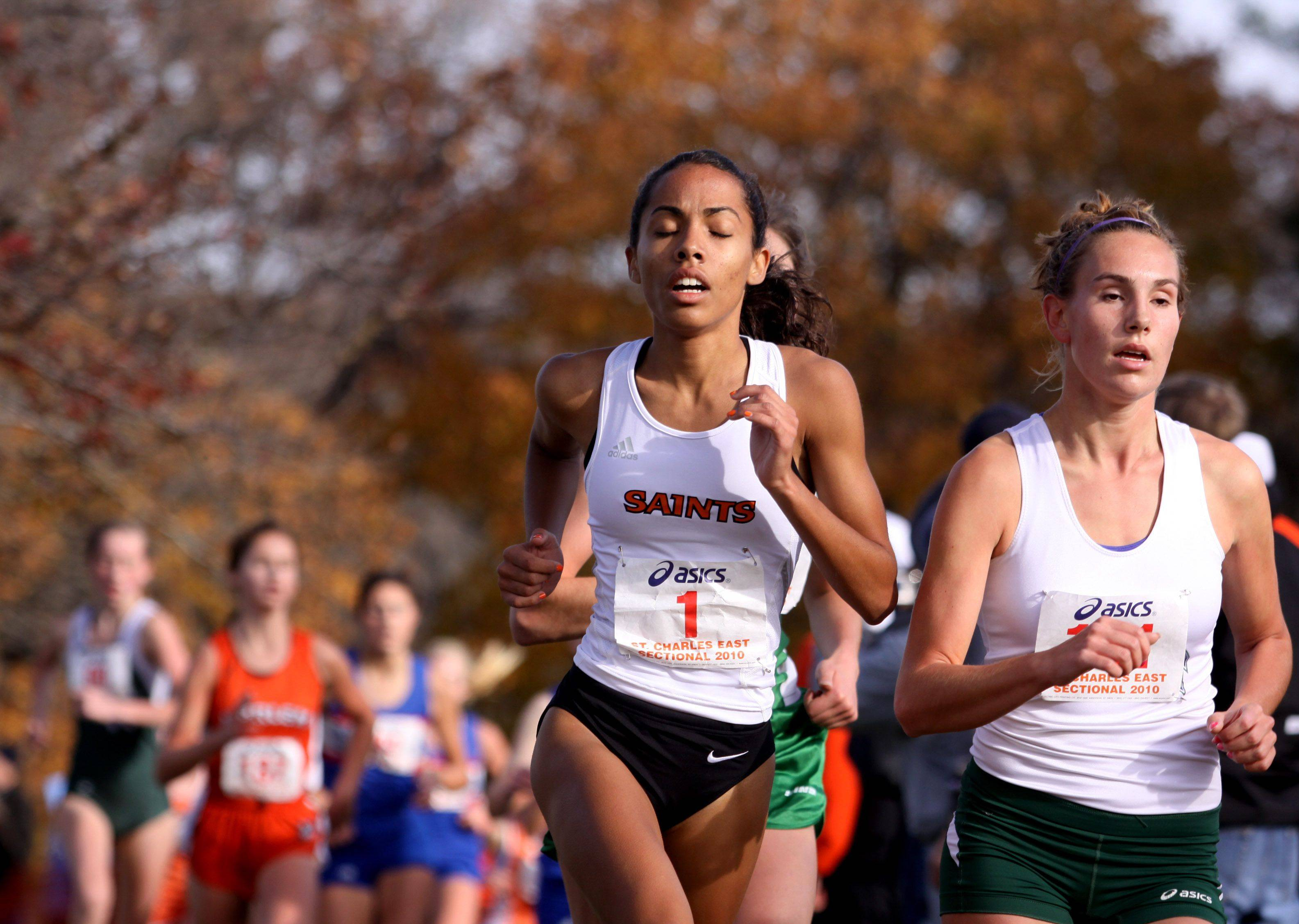 Jessica Evans, pictured running against Bartlett's Alyssa Schneider at sectionals last year, is part of a veteran St. Charles East team coming off a third-place finish at state in 2011.