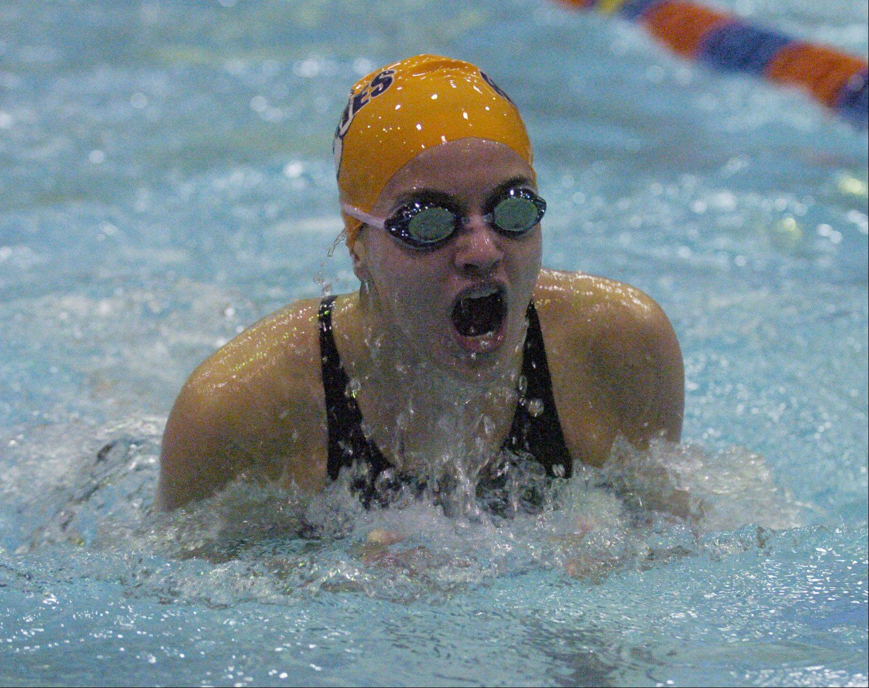 Rachel Prorok of Naperville North swims the 100-yard breast stroke during Friday's girls state swimming prelims at Evanston High School.