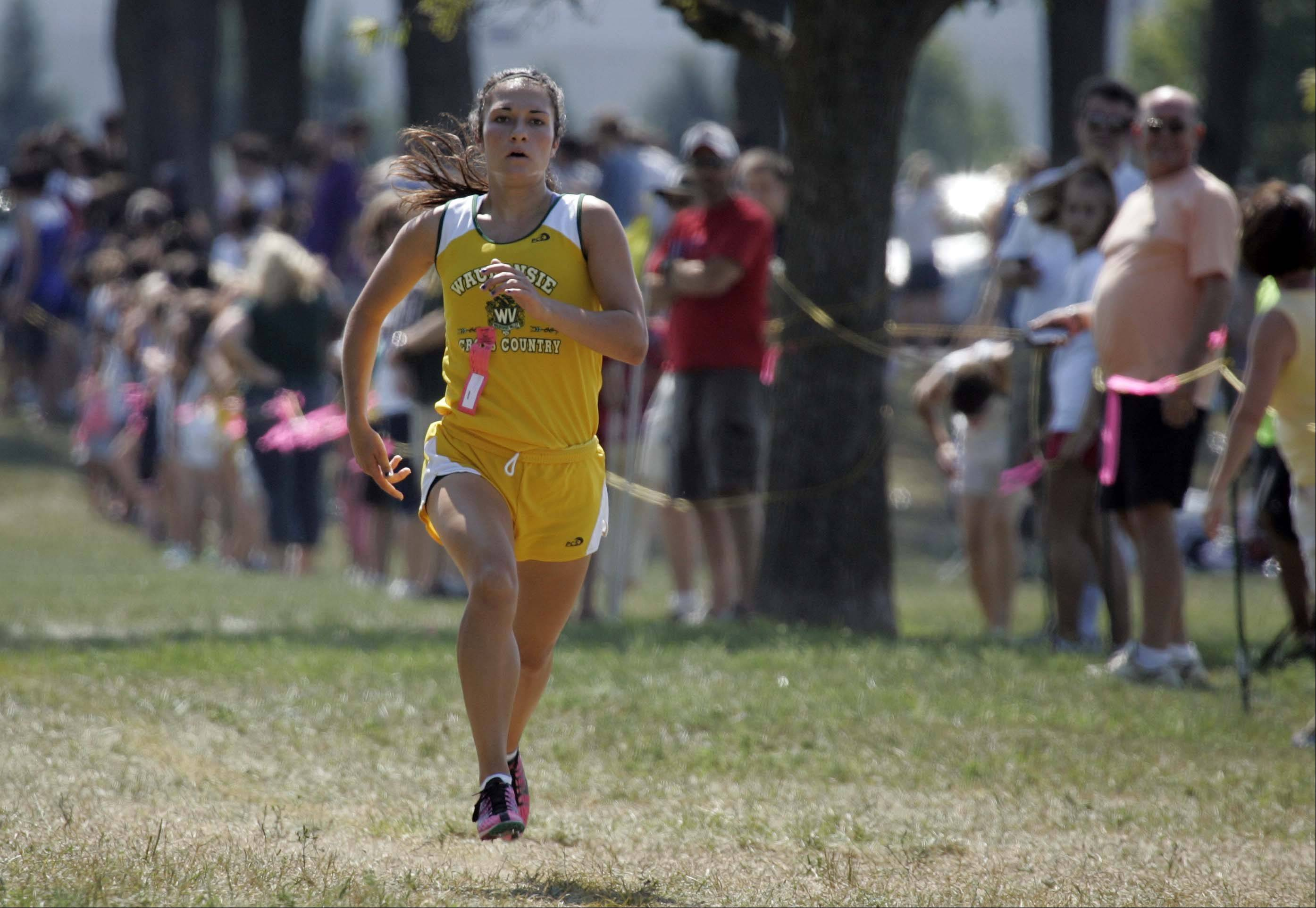 Waubonsie Valley's Ashley Bruner on the final leg to first place during the Aurora girls cross county meet at Marmion Saturday August 25, 2012.