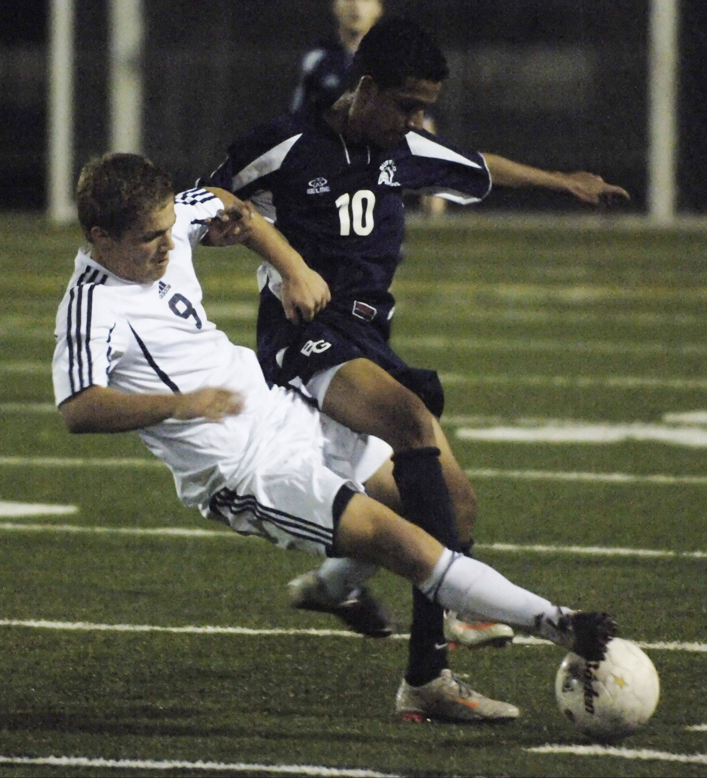 Buffalo Grove's Alberto Eloyza, right, battles with Prospect's Alex Schnepf last season in sectional semifinal action at Palatine. Eloyza, an all-MSL midfielder last season, is one of several returners who bear watching at BG.