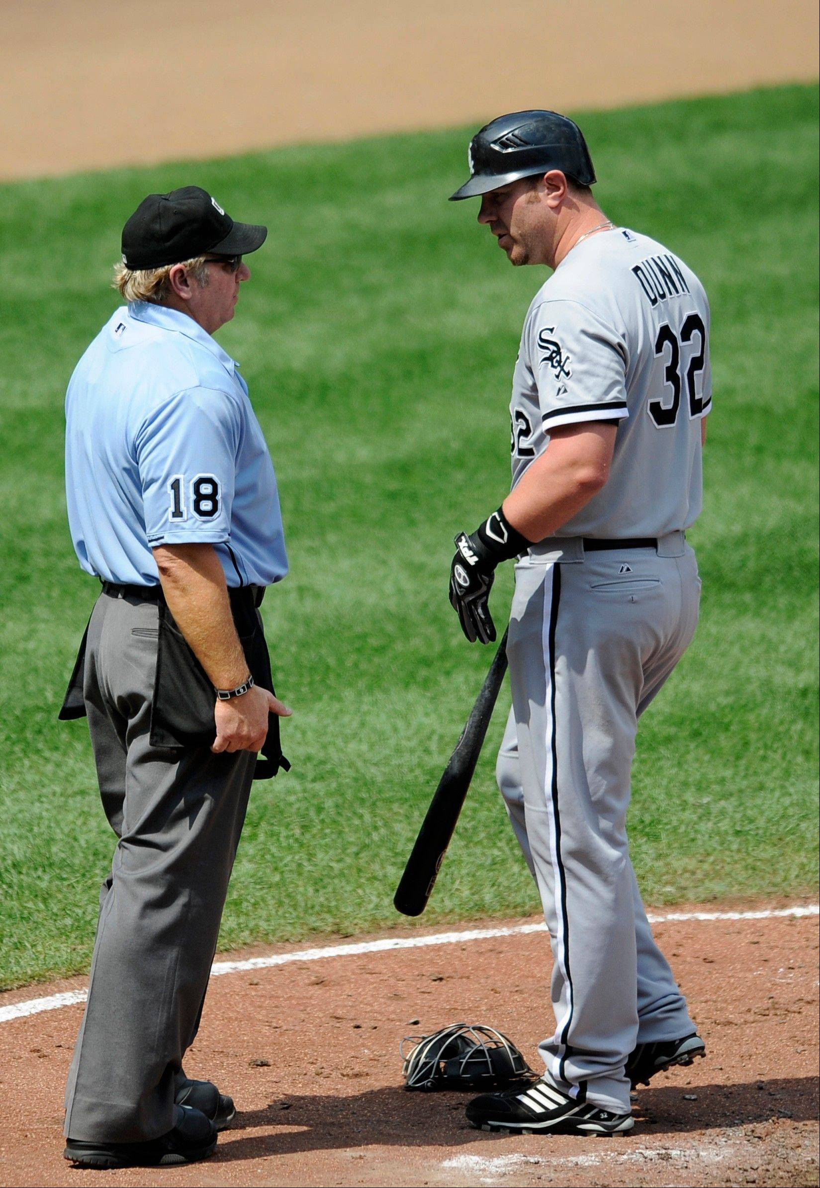 White Sox designated hitter Adam Dunn looks at home plate umpire Brian Runge after he struck out Thursday during the third inning against the Baltimore Orioles in Baltimore.