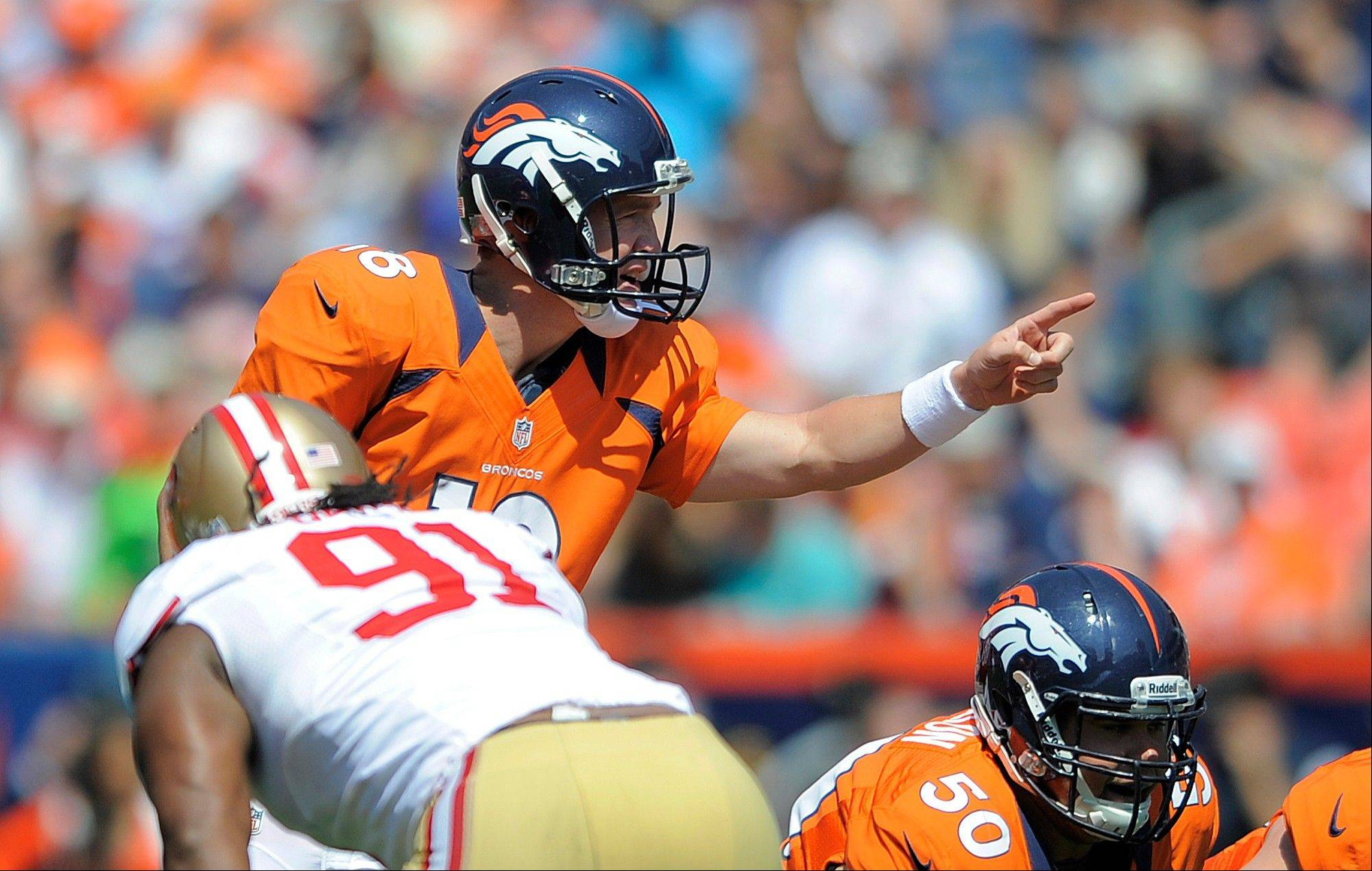 Denver Broncos quarterback Peyton Manning (18) calls a play at the line of scrimmage during the first quarter of an NFL preseason football game against the San Francisco 49ers in Denver, Sunday, Aug. 26, 2012.