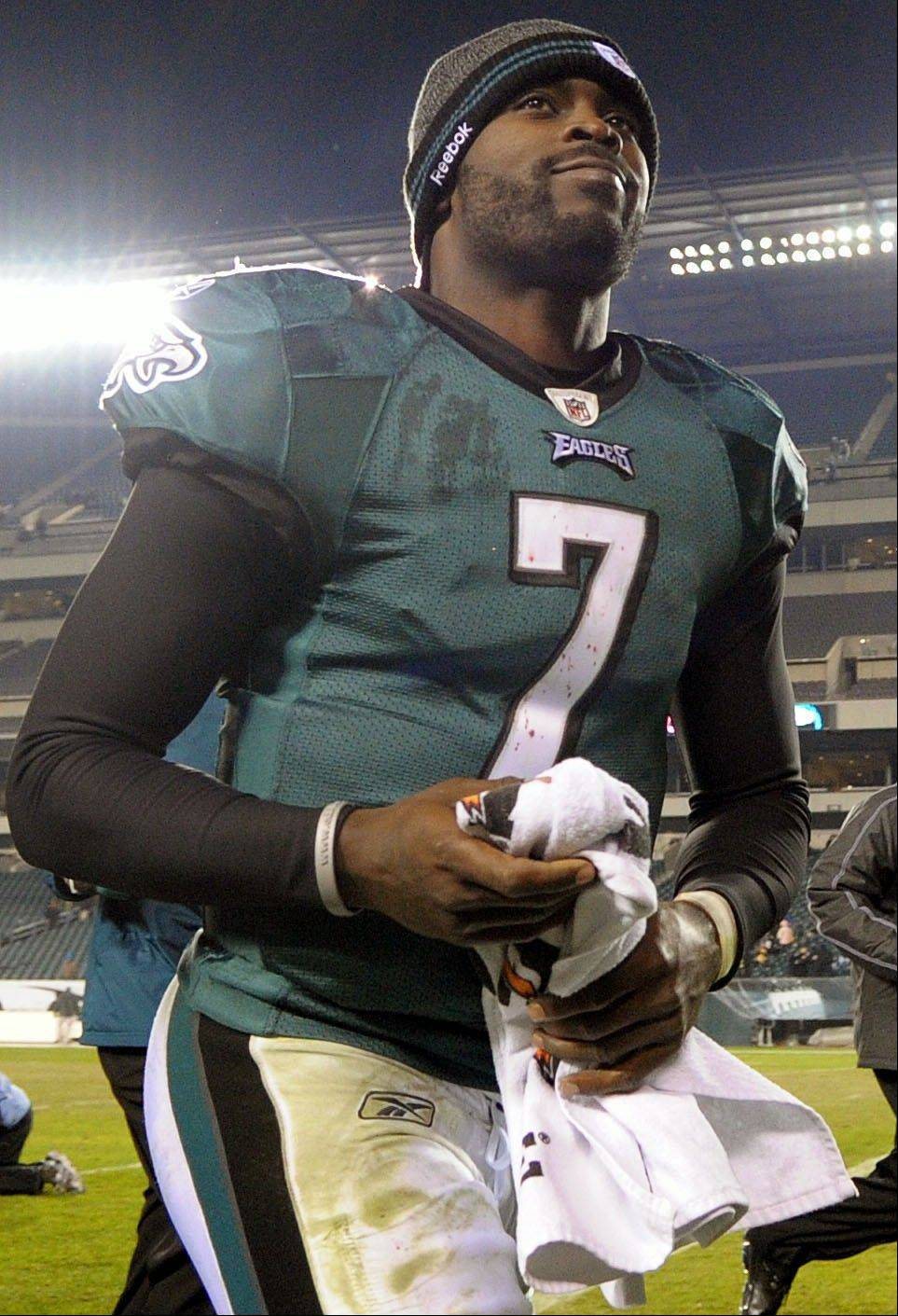 Philadelphia Eagles quarterback Michael Vick runs off the field following a win against the Dallas Cowboys, Sunday, Oct. 30, 2011, in Philadelphia.