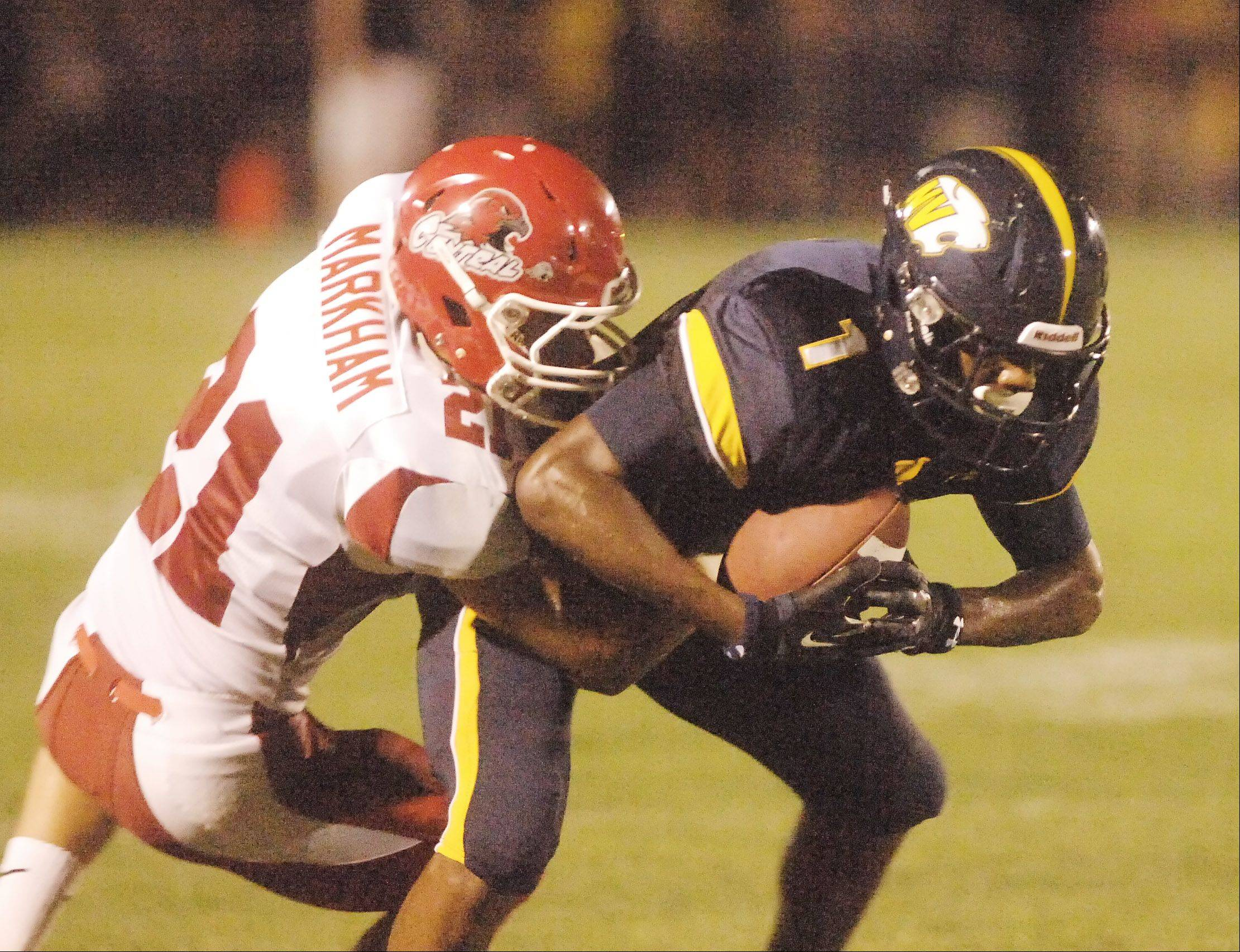 Paul Michna/pmichna@dailyherald.com Justin Markham of Naperville Central pulls down Reggie Ervin of Neuqua Vally during the Naperville Central at Neuqua Valley football game Friday.