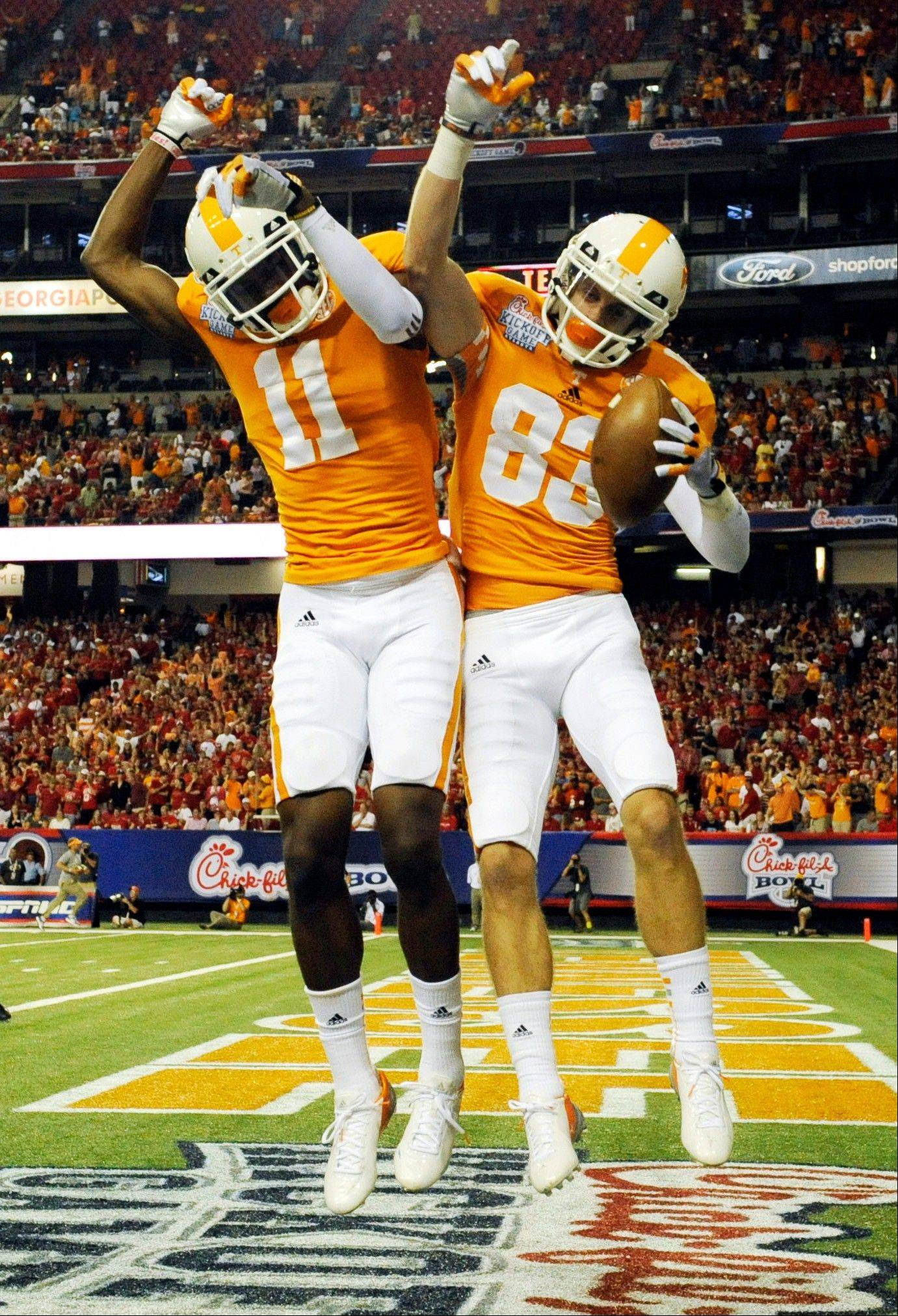 Tennessee wide receiver Zach Rogers (83) celebrates his first quarter touchdown reception with teammate Justin Hunter against North Carolina State on Friday in the Chick-fil-A Kickoff Game in Atlanta.