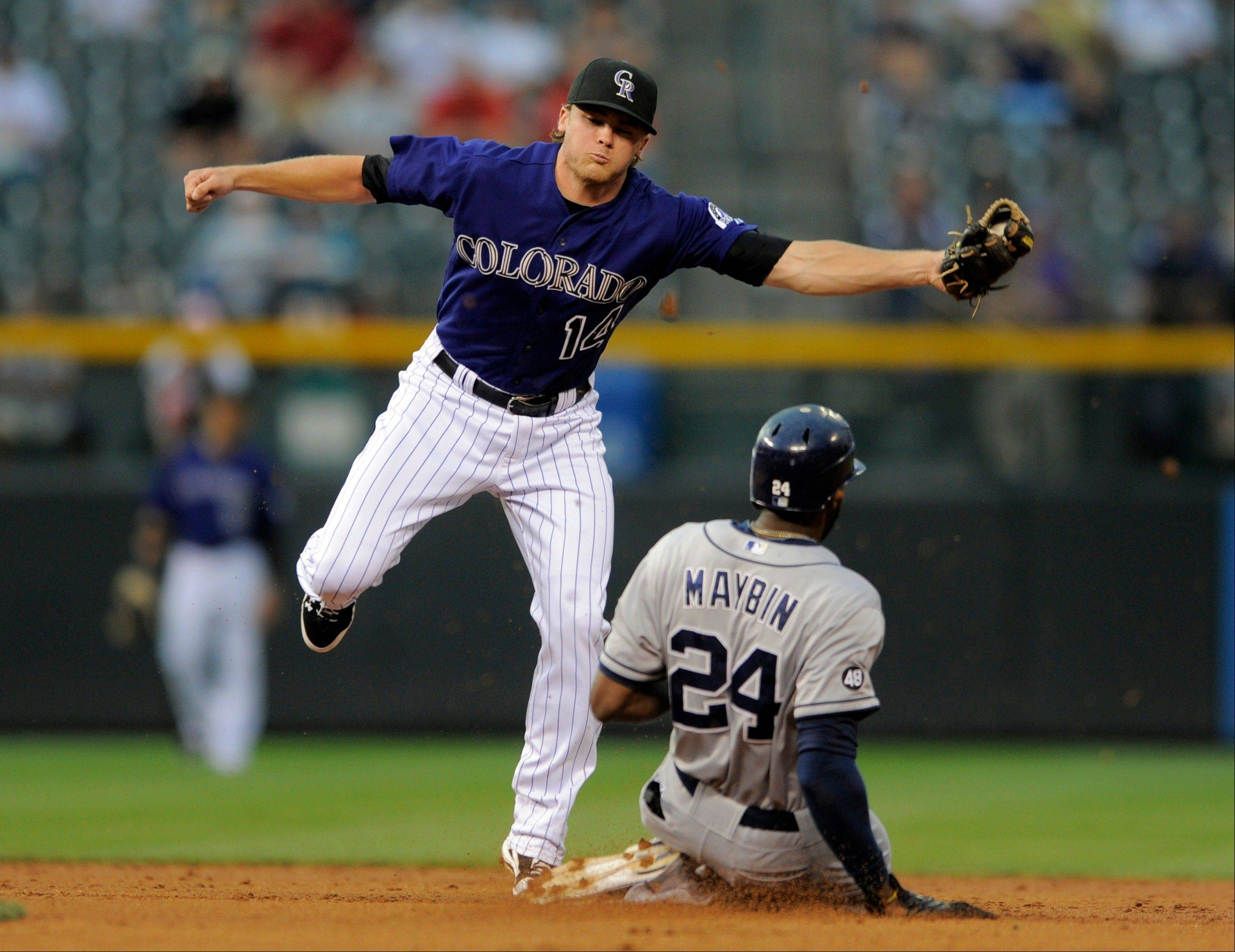San Diego's Cameron Maybin steals second as Colorado Rockies shortstop Josh Rutledge covers during the second inning Friday in Denver.