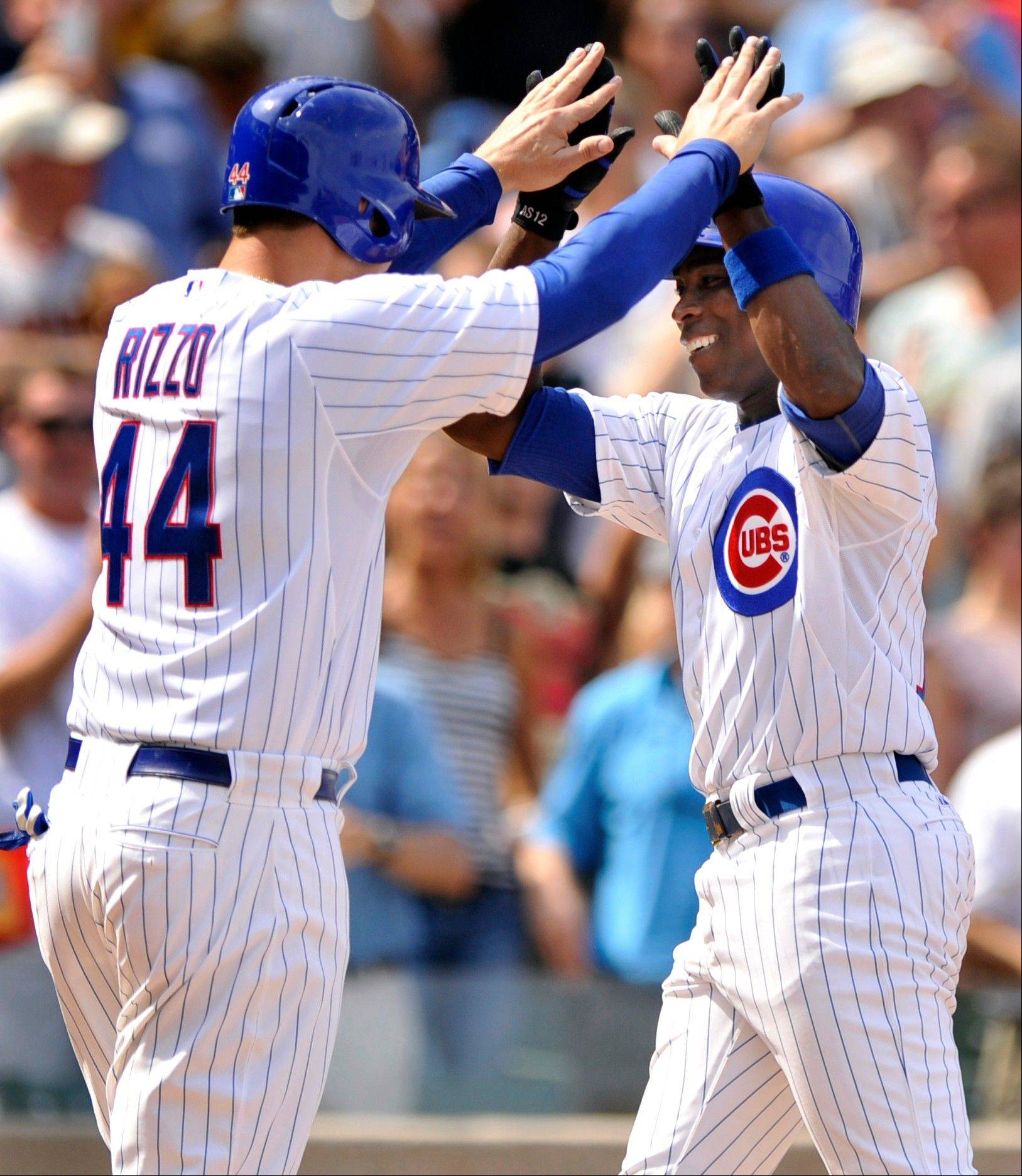 The Cubs' Alfonso Soriano celebrates with Anthony Rizzo after hitting a 2-run homer in the third inning Friday at Wrigley Field. Rizzo later added a solo shot of his own.