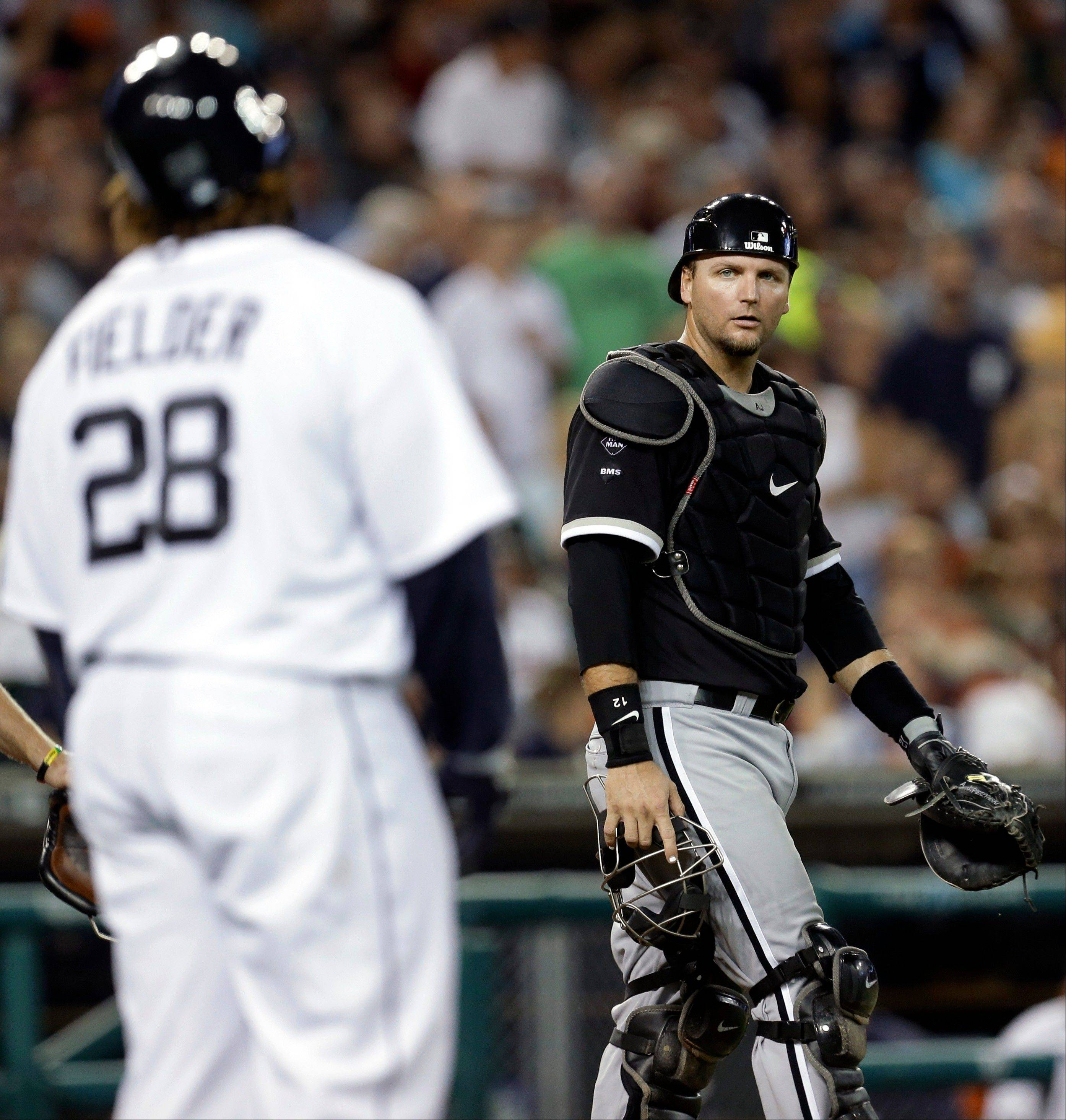 Detroit Tigers' Prince Fielder (28) talks with Chicago White Sox catcher A.J. Pierzynski, left, after being hit by a pitch from Matt Thornton in the seventh inning of a baseball game in Detroit, Friday, Aug. 31, 2012. (AP Photo/Paul Sancya)