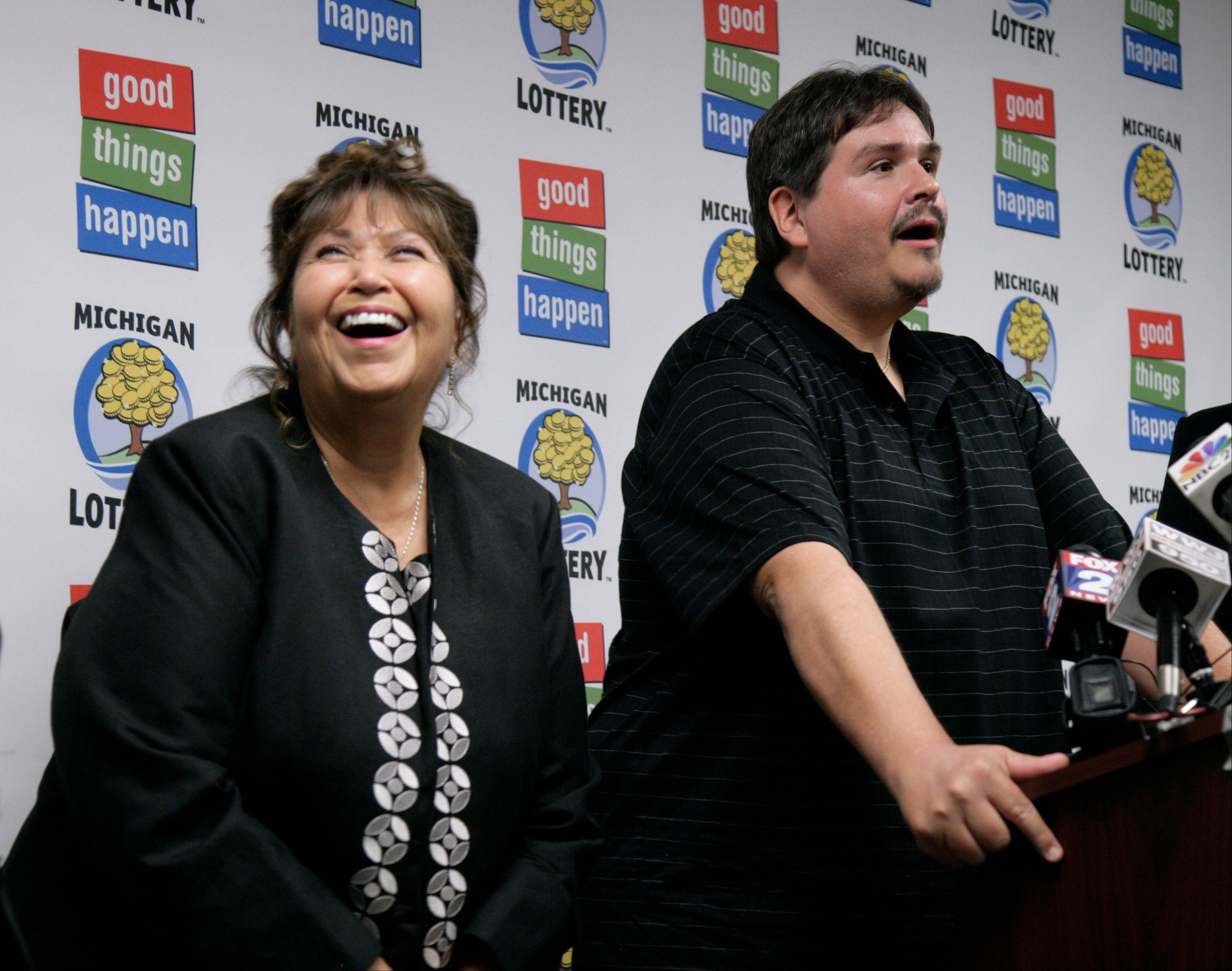 Donald Lawson, a 44-year-old Lapeer, Mich. resident, talks at a news conference Friday in which he claimed the $337 million Powerball prize as his mother, left, laughs. Lawson's mother asked to remain anonymous.