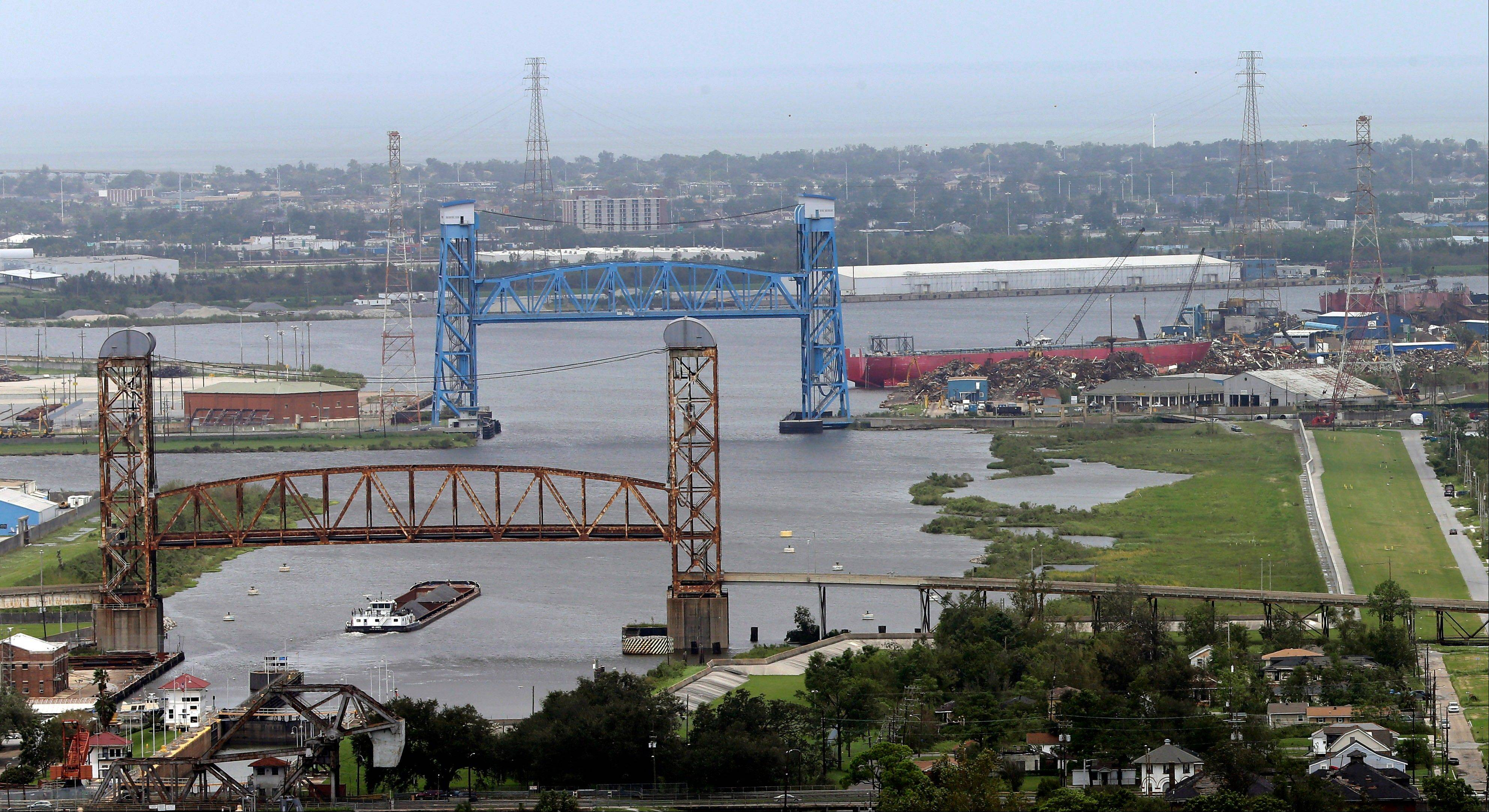 Associated PressThis aerial photo shows the Industrial Canal Friday, after Isaac hit earlier in the week in New Orleans. Floodwaters from Hurricane Katrina broke through the flood wall, right, seven years ago, covering the Lower 9th Ward neighborhood.