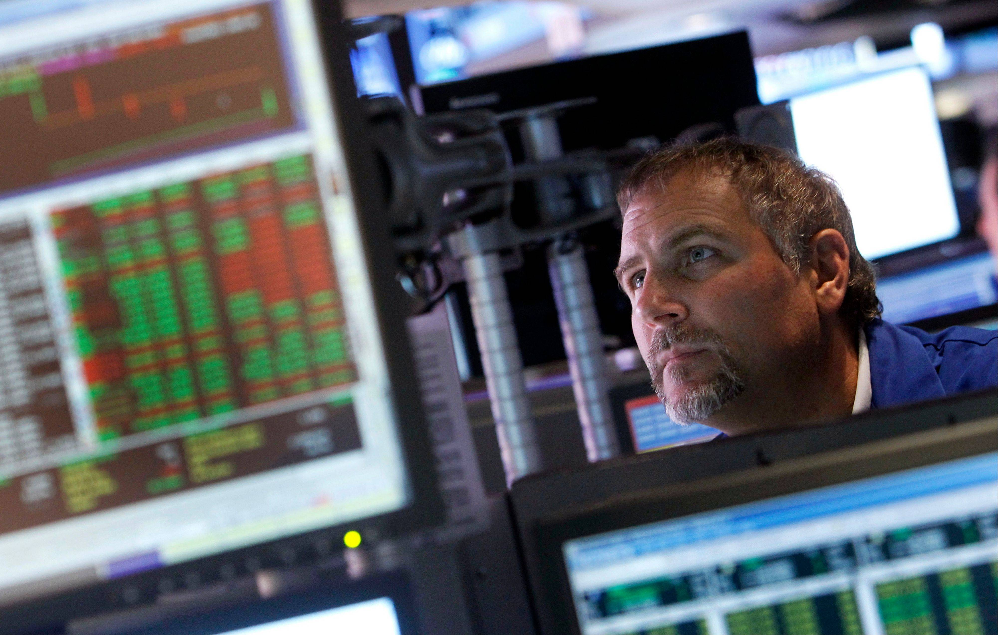 A trader works on the floor of the New York Stock Exchange Friday.