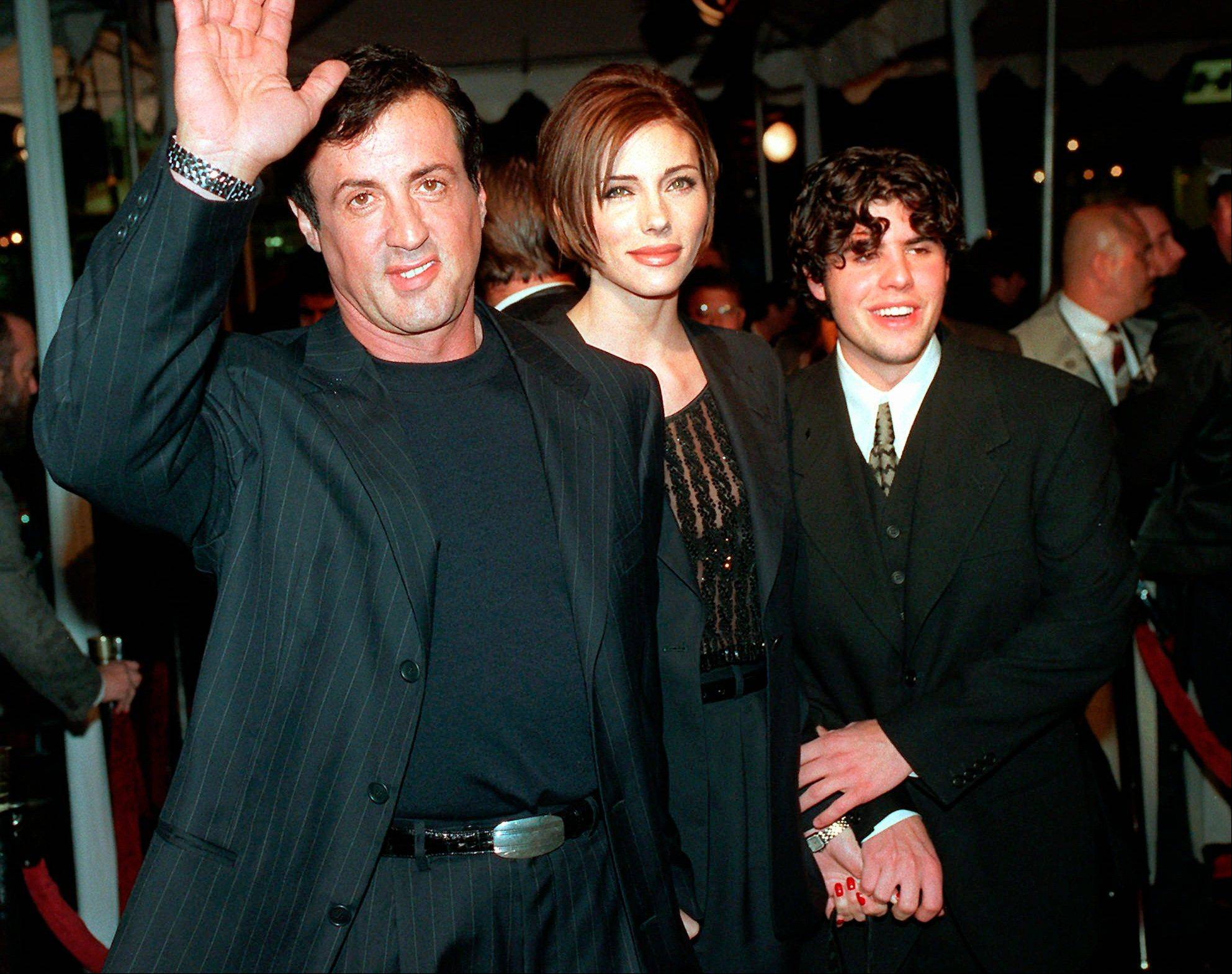 "Sylvester Stallone, left, arrives at the 1996 world premiere of ""Daylight"" with his girlfriend Jennifer Flavin, center, and his son Sage Stallone, who co-starred in the film. Coroner officials determined Thursday that Sage Stallone died from a heart condition that causes blockage of the arteries."
