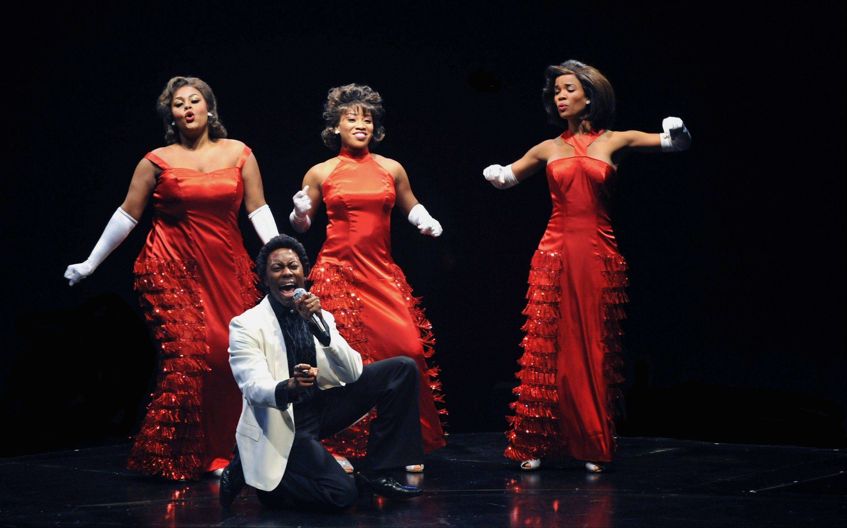 "R&B star James ""Thunder"" Early (Eric LaJuan Summers) sizzles with the addition of his dreamy backup singers Effie (Raena White, left), Lorrell (Rashidra Scott, center) and Deena (Britney Coleman) in Marriott Theatre's revival of ""Dreamgirls."""