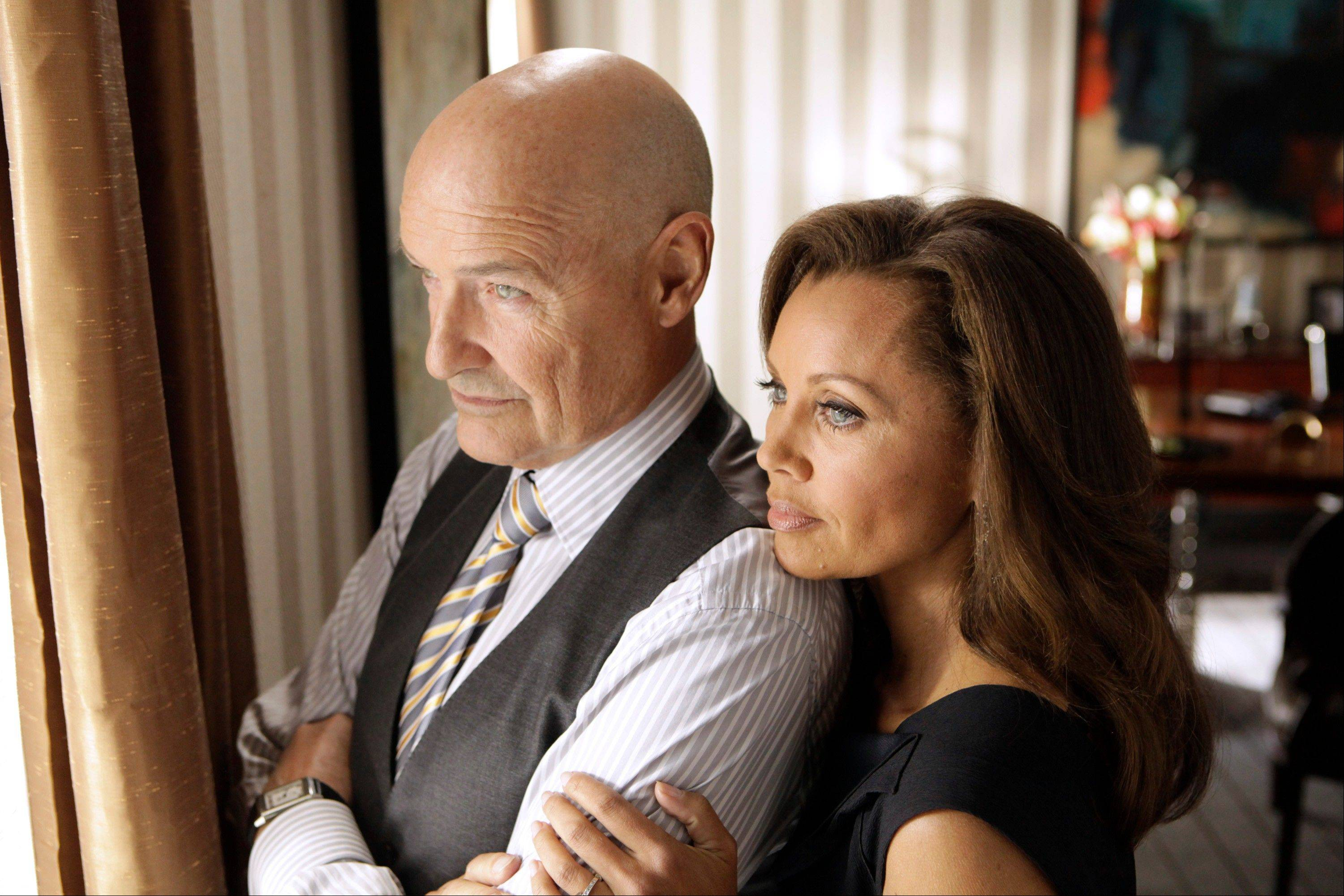 "Devilish landlords (Terry O'Quinn and Vanessa Williams) keep tabs on their trapped tenants in the ABC series ""666 Park Avenue."""