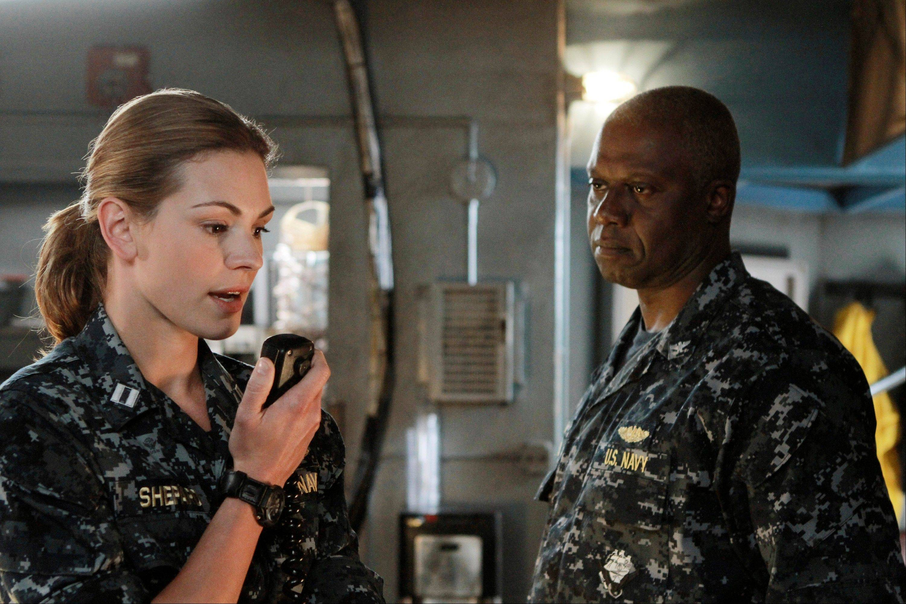 "A submarine crew becomes a target in ABC's ""Last Resort,"" starring Daisy Betts, left, and Andre Braugher."