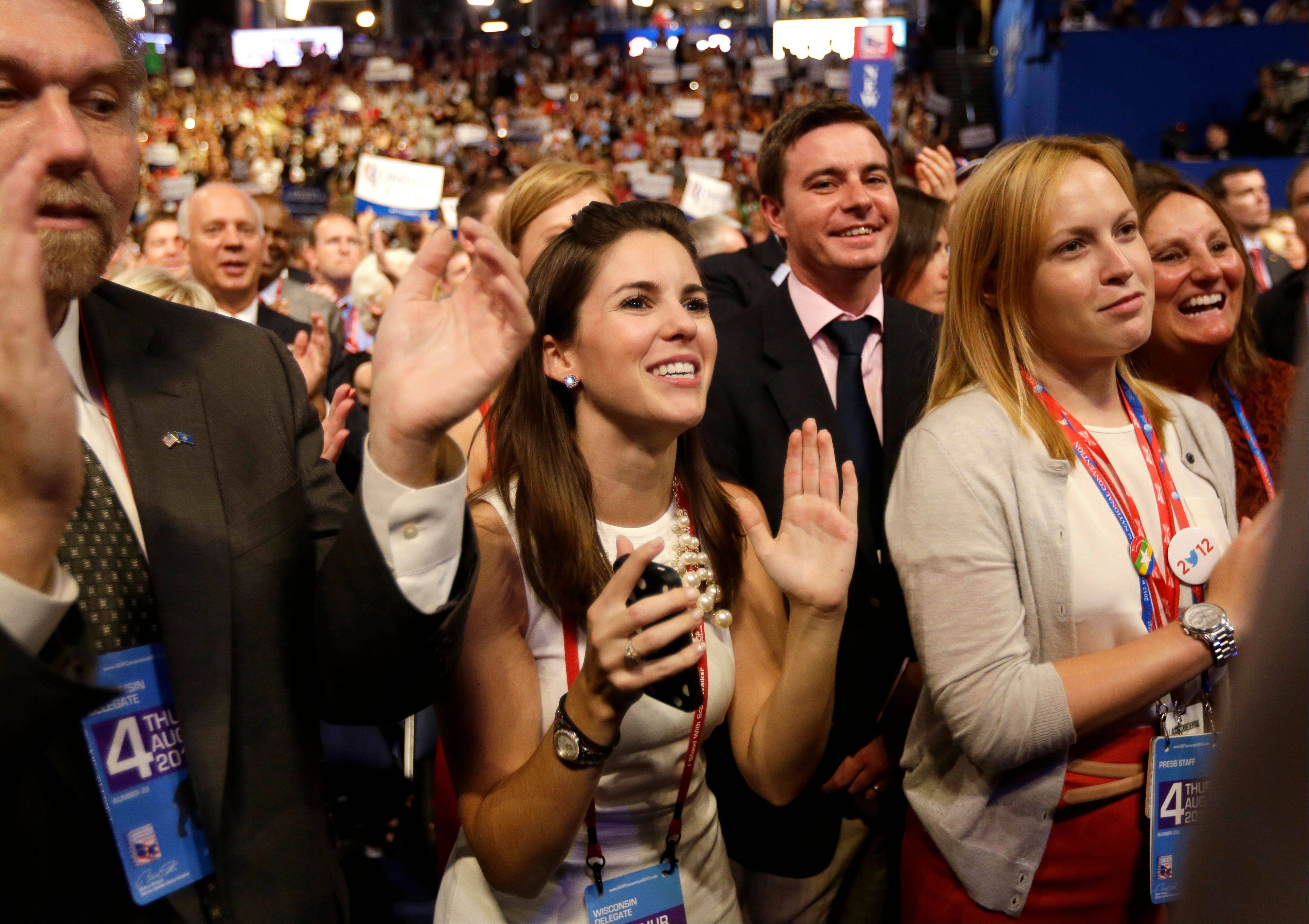 Delegates react as Republican presidential nominee Mitt Romney addresses delegates Thursday before speaking at the Republican National Convention in Tampa, Fla.