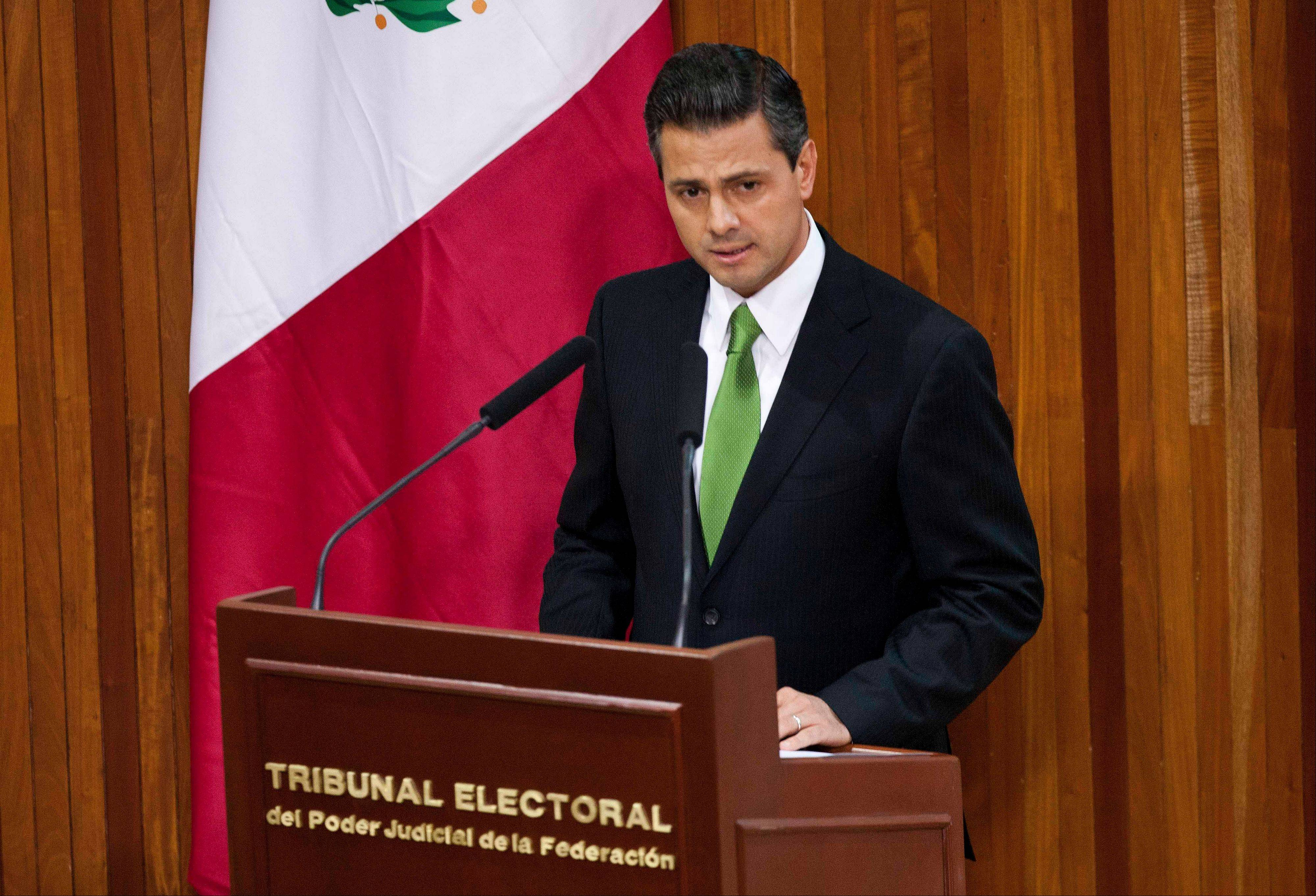 Mexico's President-elect Enrique Pena Nieto of the Institutional Revolutionary Party (PRI) speaks Friday during a ceremony at which the Federal Electoral Tribunal declared he won the majority of votes in last July's presidential election, in Mexico City.