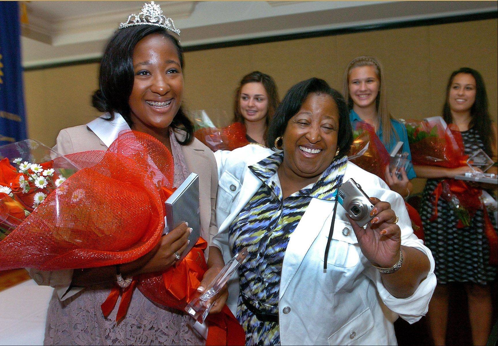 Schaumburg's Miss Septemberfest 2012, Mariah Ghant, is congratulated by her mom, Adrian Greenwood, after being crowned Friday at Bridges of Poplar Creek Country Club in Hoffman Estates.
