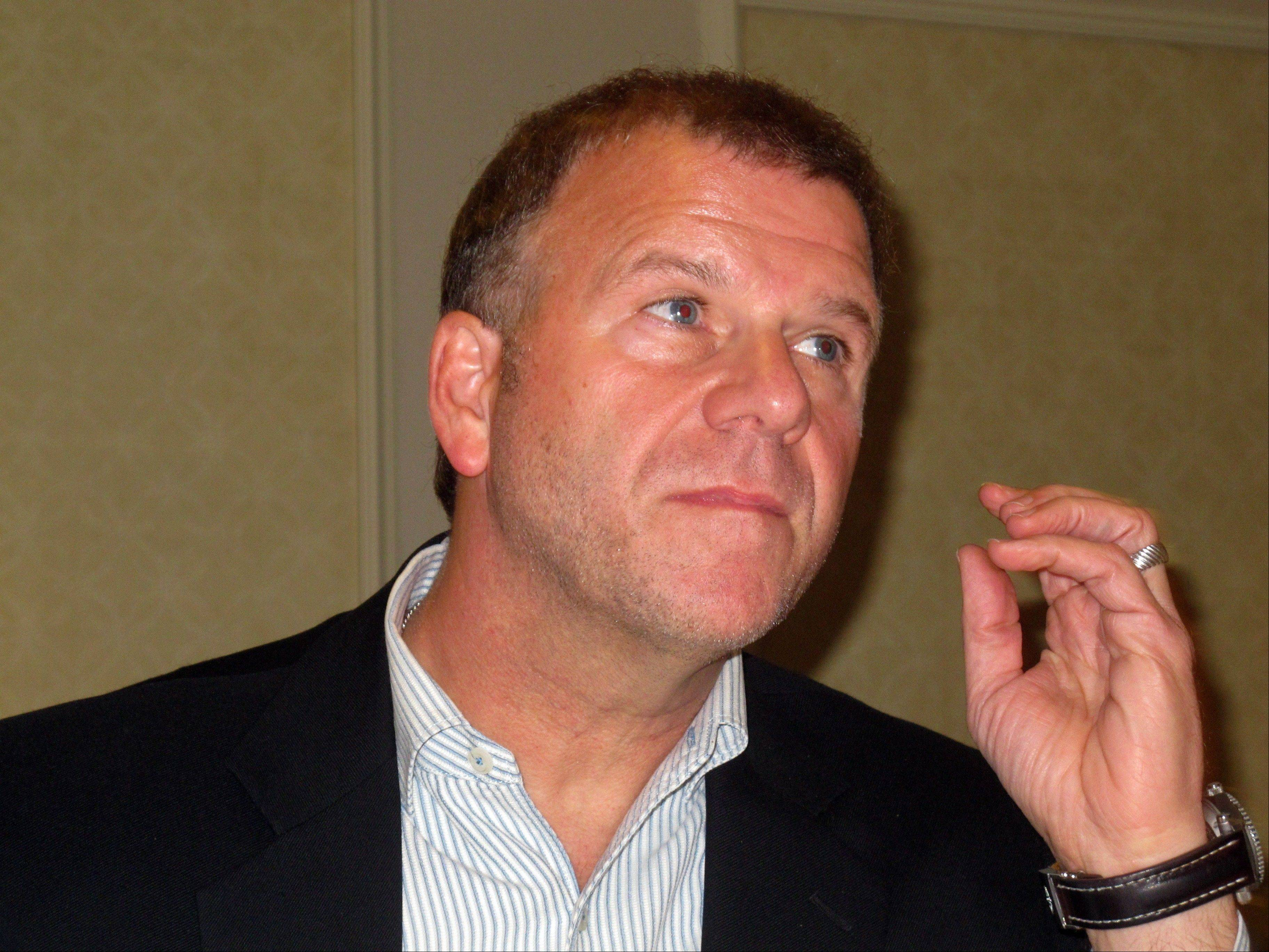 Tilman Fertitta, owner of the Golden Nugget Atlantic City, announces at a news conference Friday at his Atlantic City, N.J., casino, that the casino will let gamblers cash in nearly $1 million worth of chips they won at card games in which the cards were not shuffled.