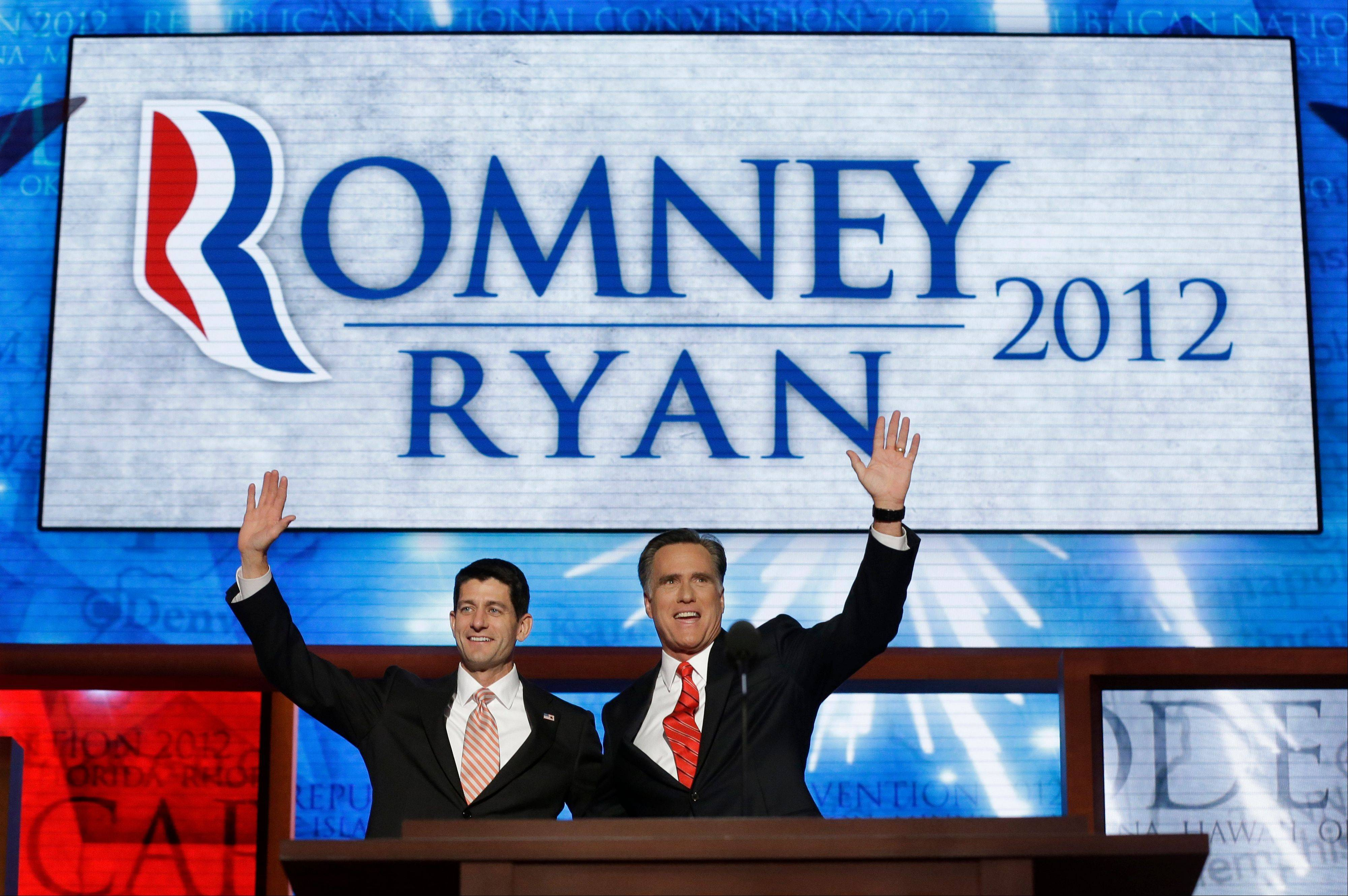 Republican presidential nominee Mitt Romney joined Thursday by Republican vice presidential nominee, Rep. Paul Ryan, waves to delegates. Fo