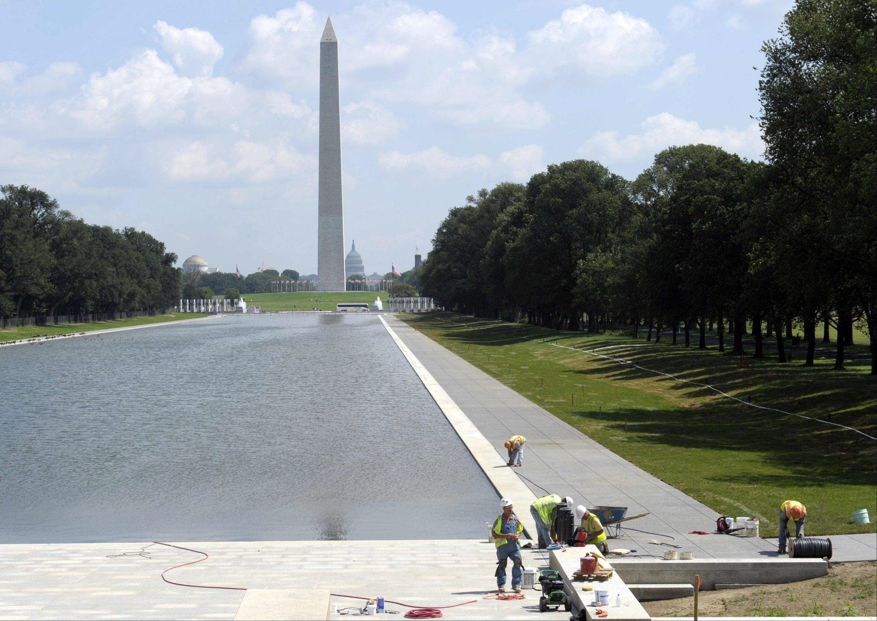 Construction workers finish up work Tuesday on the Lincoln Memorial Reflecting Pool in Washington.