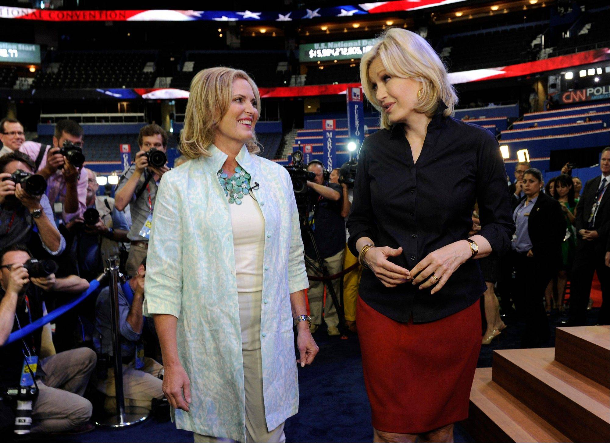 This Aug. 28, 2012 photo released by ABC shows Ann Romney, wife of U.S. Republican presidential candidate Mitt Romney, left, wearing a casual ensemble with ABC News' Diane Sawyer during an interview on the convention floor prior to Ann Romney's evening address at the Republican National Convention from Tampa, Fla.