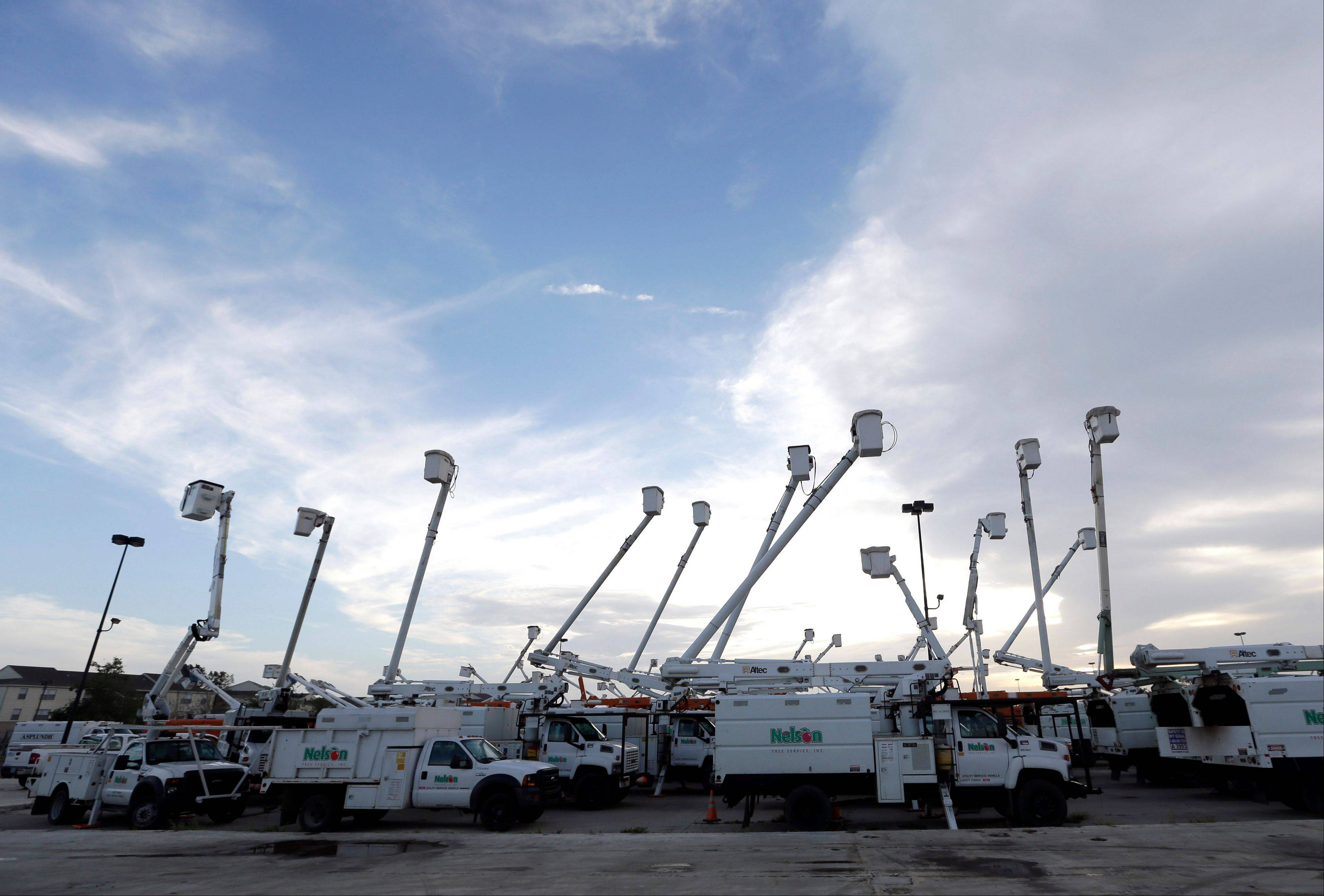 Utility trucks stage outside New Orleans as recovery efforts after Hurricane Isaac continue in New Orleans, Friday, Aug. 31, 2012. Isaac is now a tropical depression and the center was on track to cross Arkansas on Friday and southern Missouri on Friday night, spreading rain as it goes.