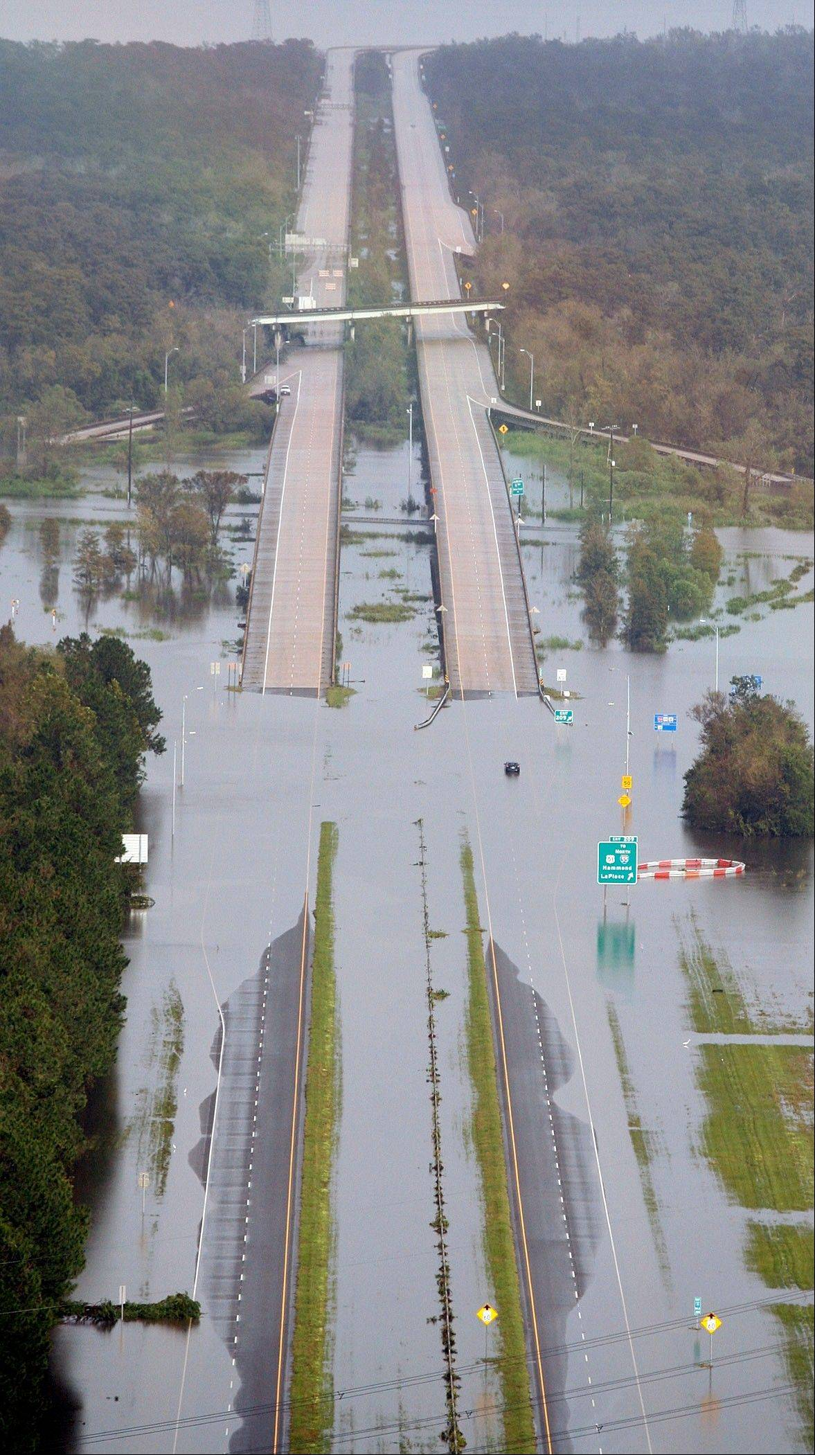 Interstate 10 in LaPlace, La. at the approach of the Twelve Mile Bridge is underwater because of Hurricane Isaac Thursday, August 30, 2012. Isaac soaked Louisiana for yet another day and pushed more water into neighborhoods all around the city, flooding homes and forcing last-minute evacuations and rescues. New Orleans itself was spared, thanks in large part to a levee system built after Katrina.