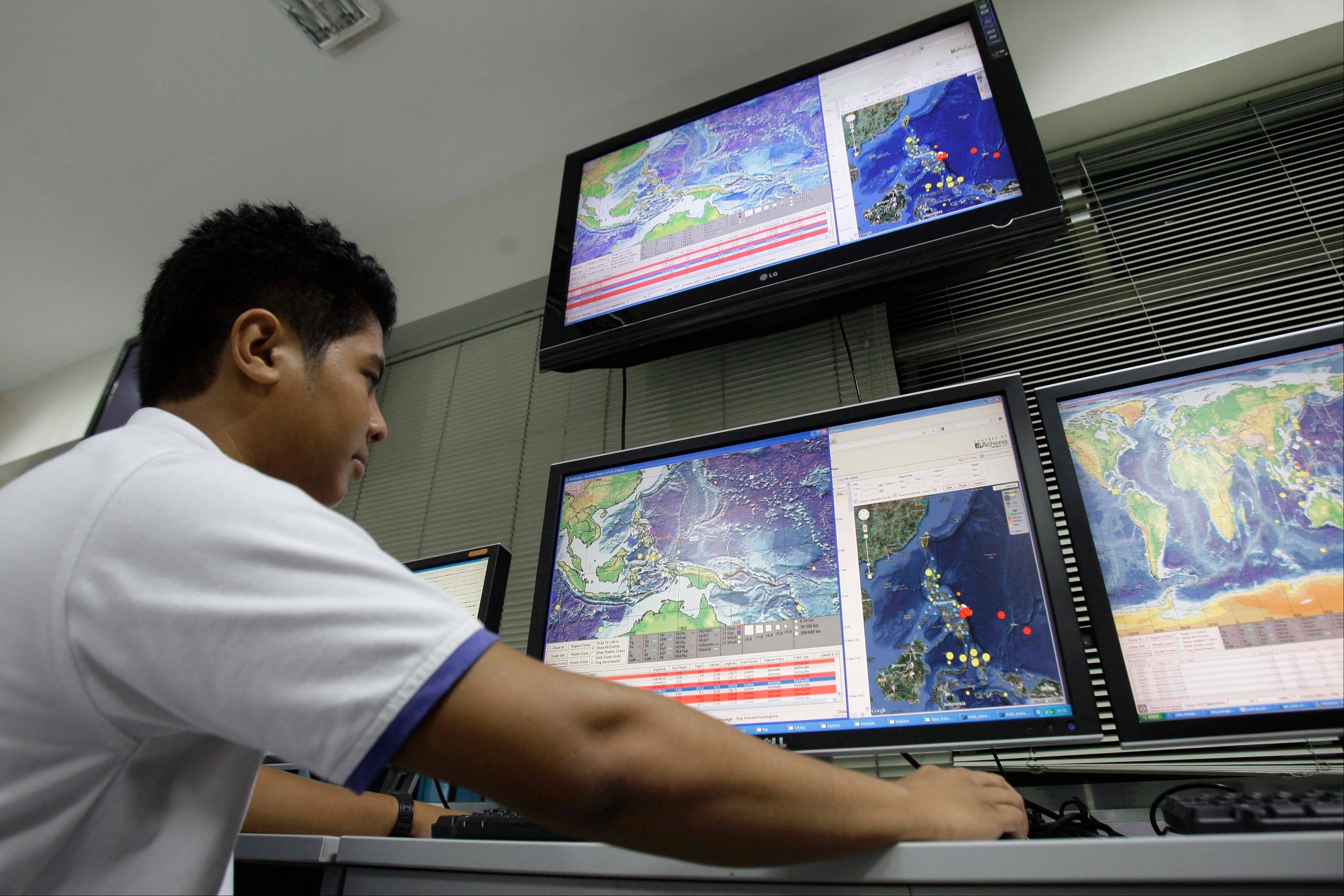 Filipino Engineer Ponzch Colleen Alcones watches the Automatic Earthquake Plotter as they continue to monitor actitivies at the Philippine Institute of Volcanology and Seismology in suburban Quezon City, north of Manila, Philippines on Friday Aug. 31, 2012. A 7.6-magnitude quake struck off the eastern coast of the Philippines late Friday, killing at least one person in a house collapse and setting off small tsunami waves about 0.1-foot-high. Most coastal residents fled to high ground and power was knocked out in several cities.