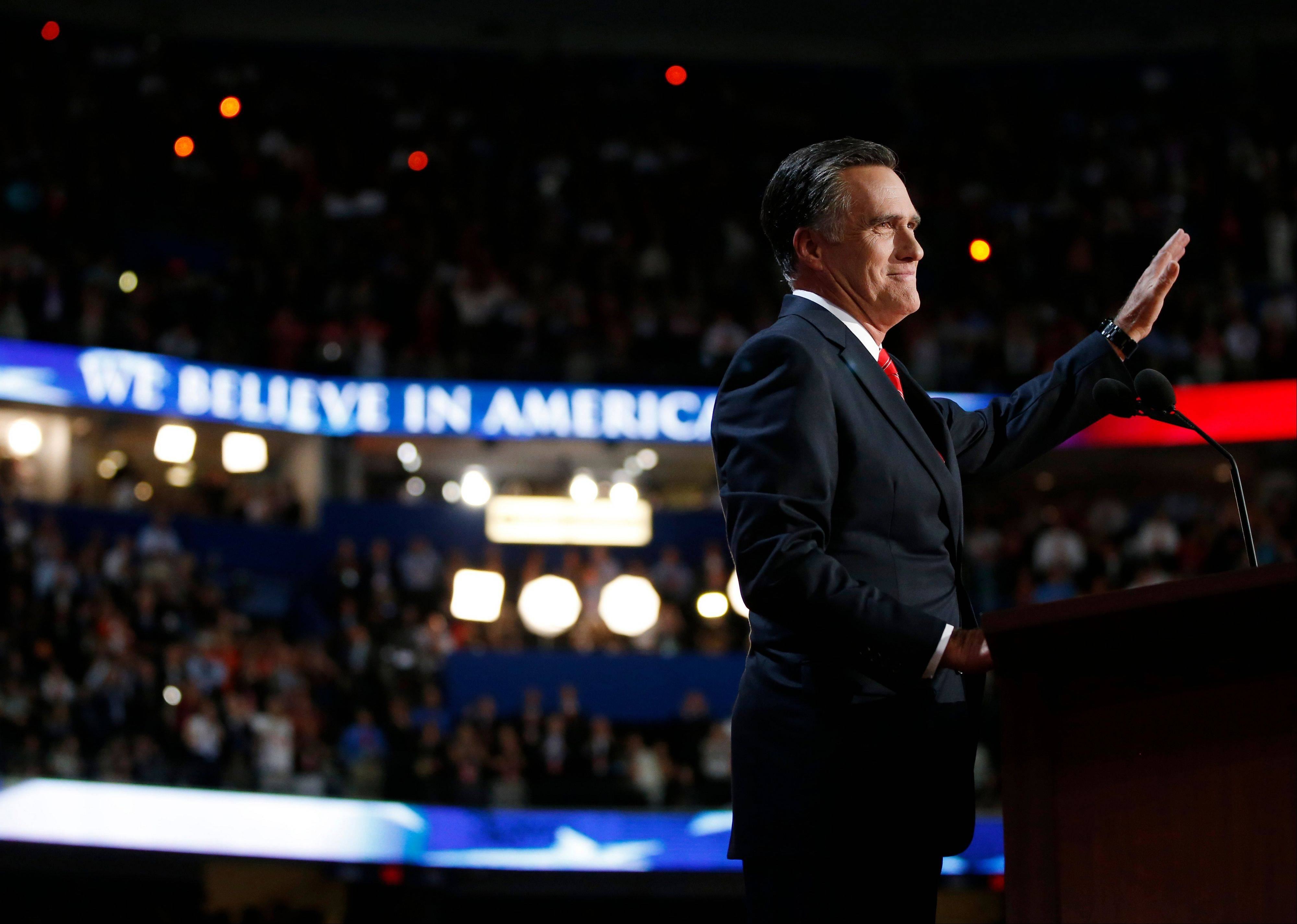 Republican presidential nominee Mitt Romney acknowledges delegates before speaking at the Republican National Convention in Tampa, Fla., Thursday.