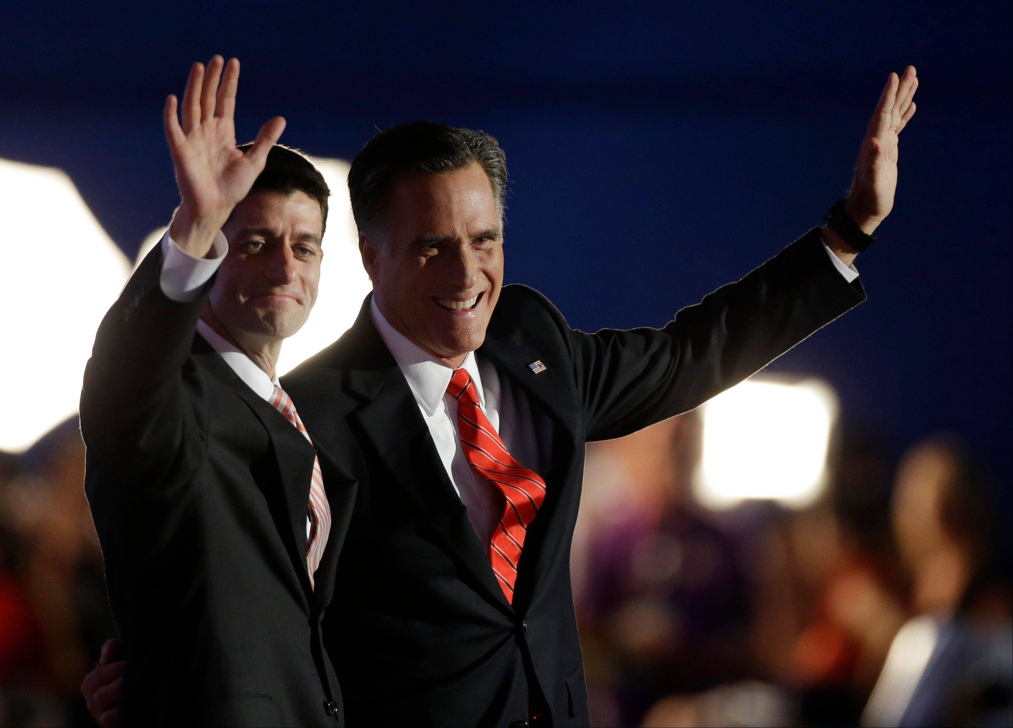 Republican vice presidential nominee, Rep. Paul Ryan, left and Republican presidential nominee Mitt Romney waves to delegates after his speech at the Republican National Convention in Tampa, Fla., on Thursday, Aug. 30, 2012.