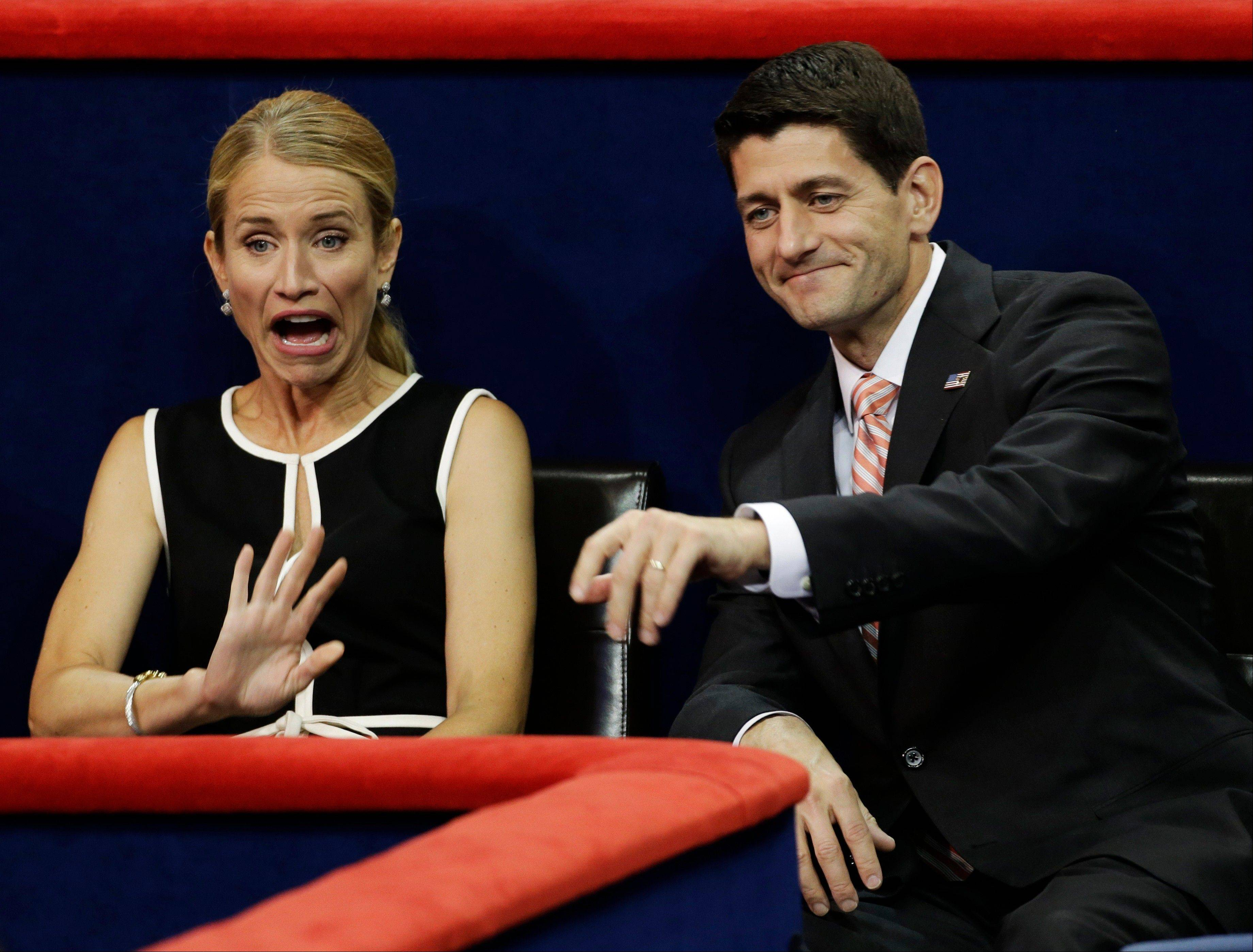 Republican vice presidential nominee, Rep. Paul Ryan and his wife Janna waves to delegates during the Republican National Convention in Tampa, Fla., on Thursday, Aug. 30, 2012.