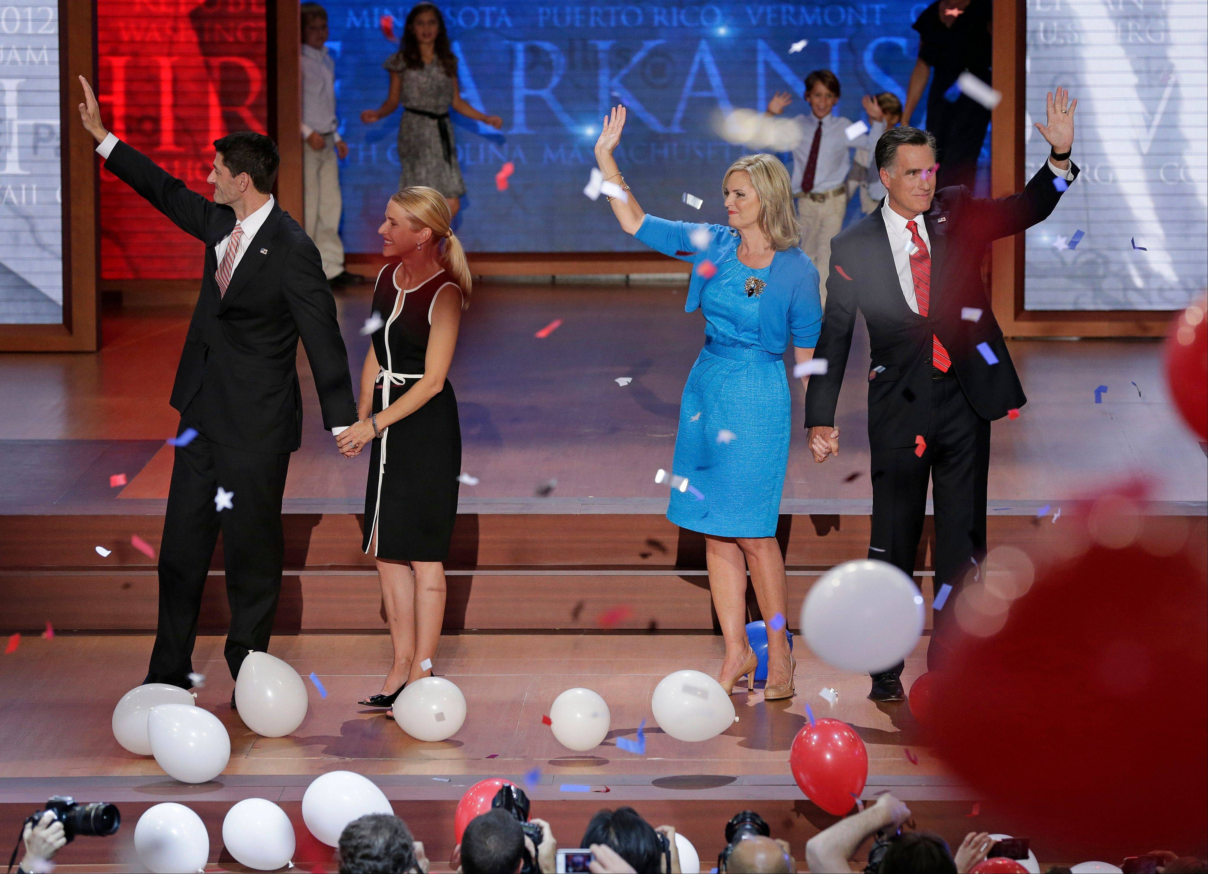Republican vice presidential nominee, Rep. Paul Ryan, Janna Ryan, Ann Romney and Republican presidential nominee Mitt Romney wave to the delegates during the Republican National Convention in Tampa, Fla., on Thursday, Aug. 30, 2012.