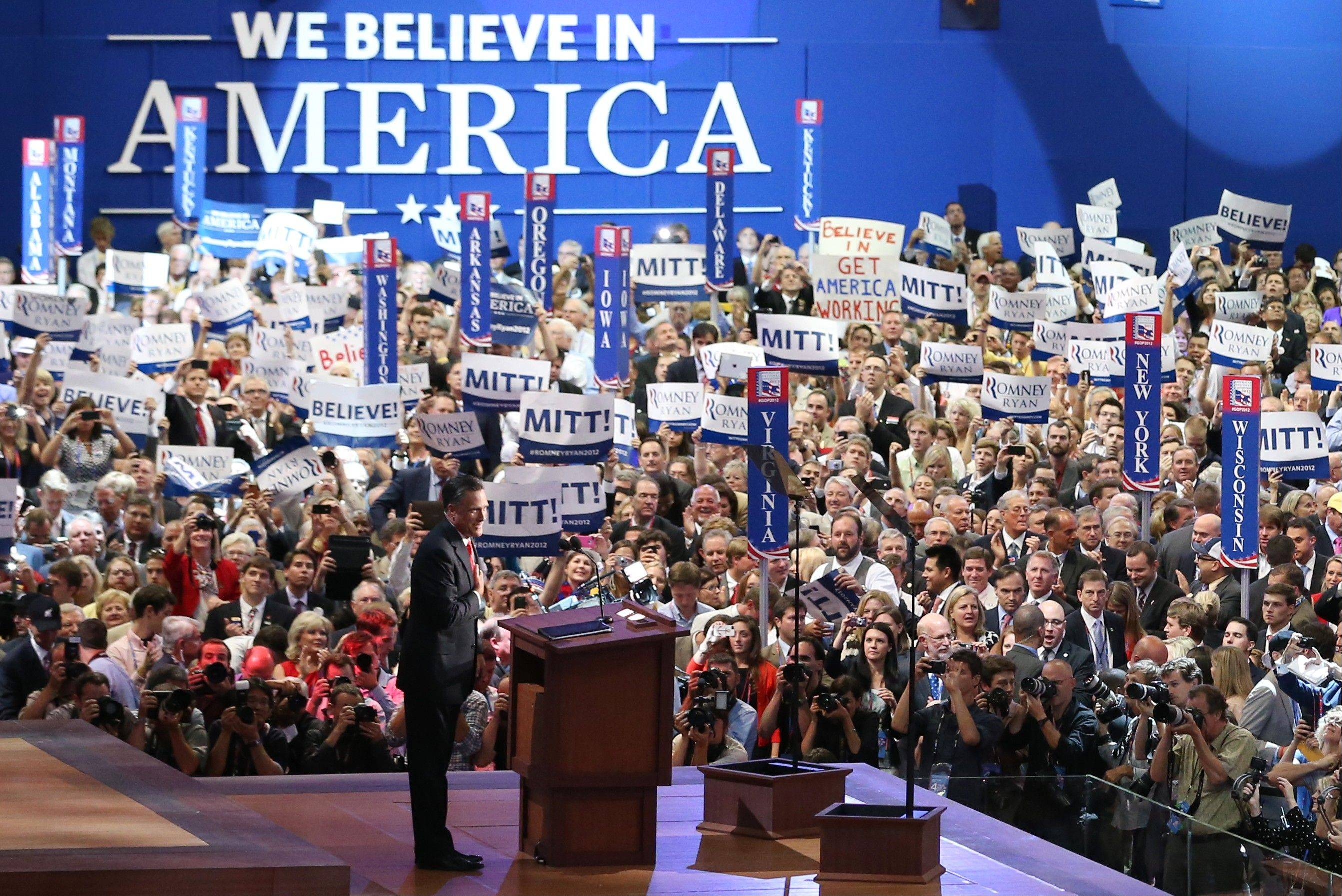 Republican presidential nominee Mitt Romney acknowledges delegates before speaking at the Republican National Convention in Tampa, Fla., on Thursday, Aug. 30, 2012.