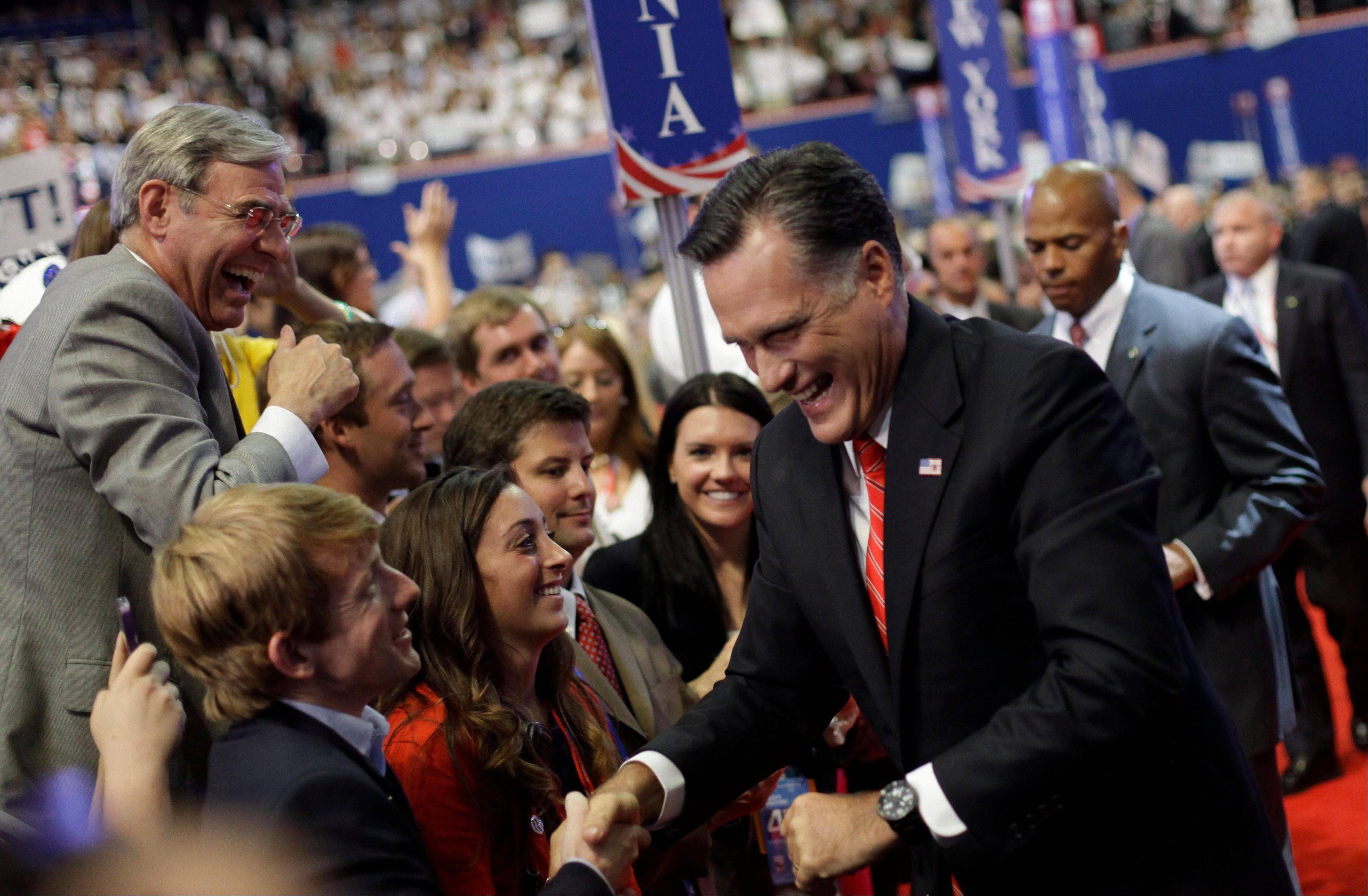 Republican presidential nominee Mitt Romney shakes hands of delegates before speaking at the Republican National Convention in Tampa, Fla., on Thursday, Aug. 30, 2012.