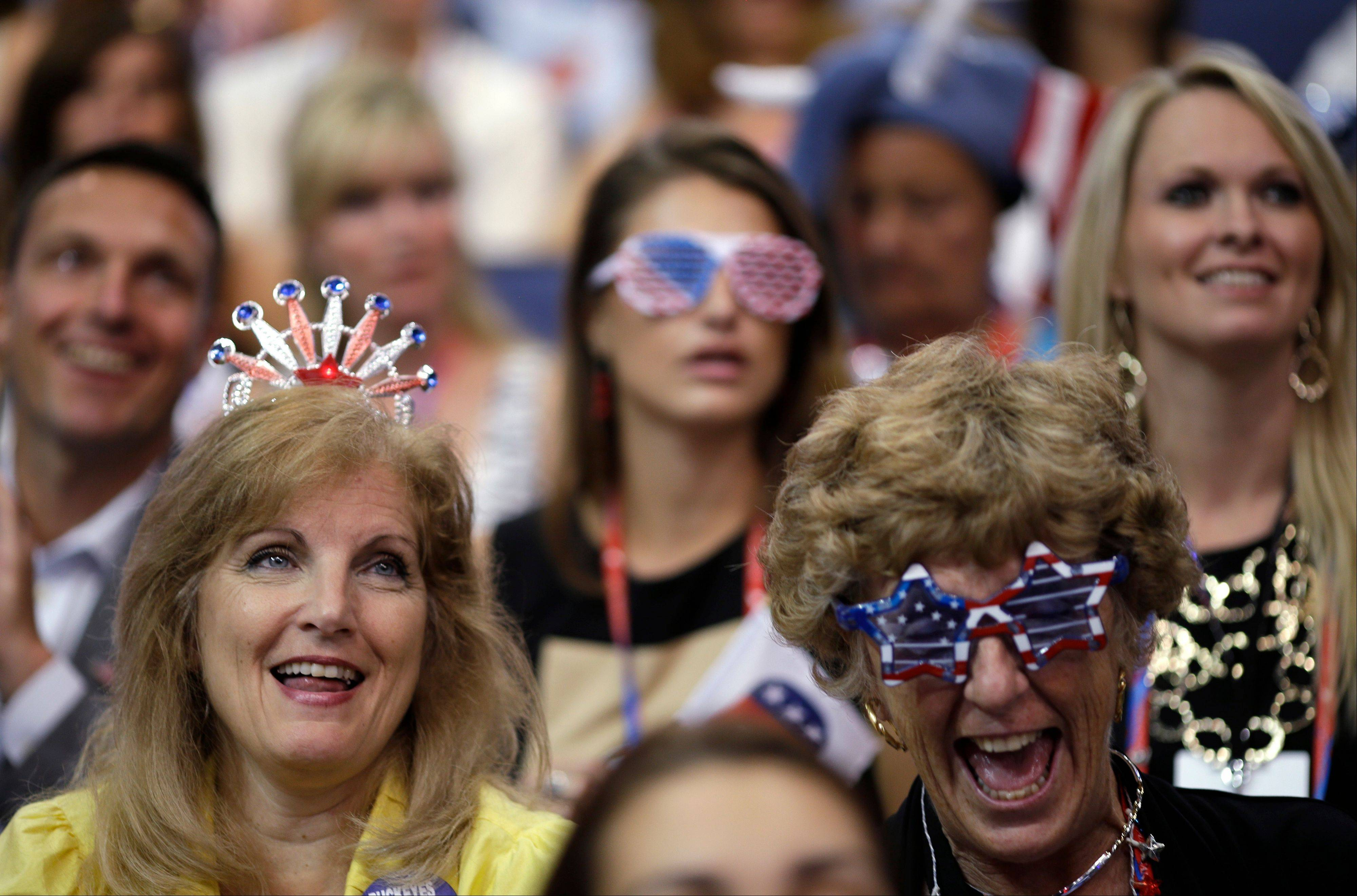 Ohio delegates Becky Lynch, left, from Menton, and Lyn Bliss from Greenville react during the Republican National Convention in Tampa, Fla., on Thursday, Aug. 30, 2012.