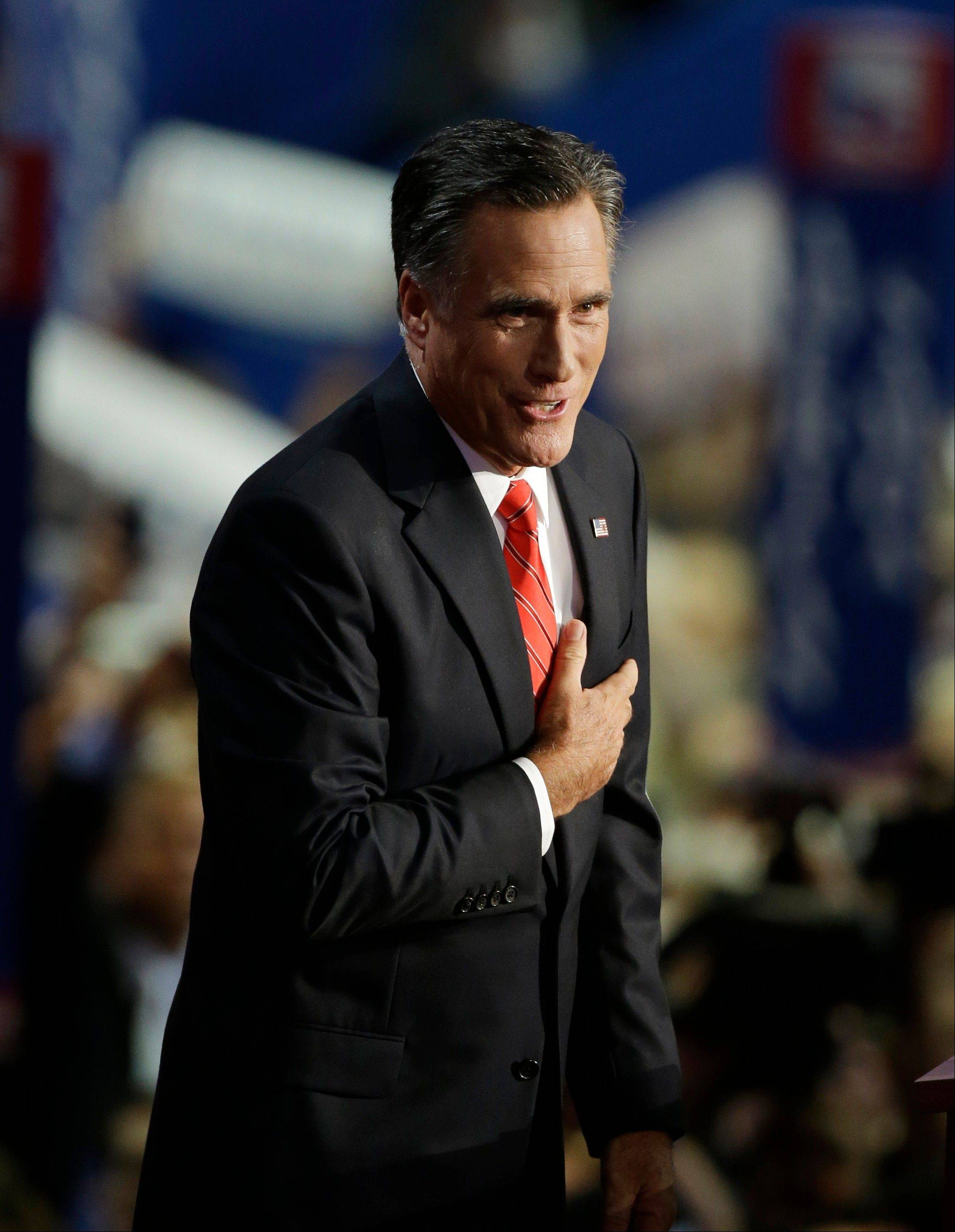 Mitt Romney accepts the nomination as the Republican candidate for U.S. president during the Republican National Convention in Tampa, Fla., on Thursday, Aug. 30, 2012.