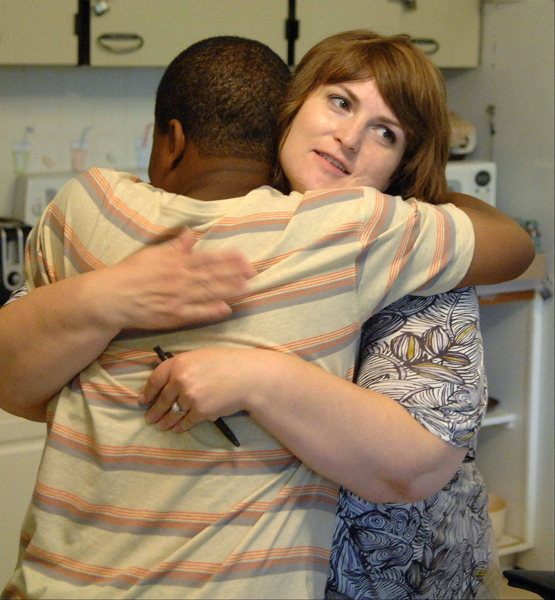 Erin Brumfield Grima hugs a client who is being stepped down to a foster home after completing his therapy at Larkin Center in Elgin. Brumfield Grima is a therapist and administrator at Larkin Center. The kids in her residential unit are 8 to 15 who have had sexually problematic behavior.