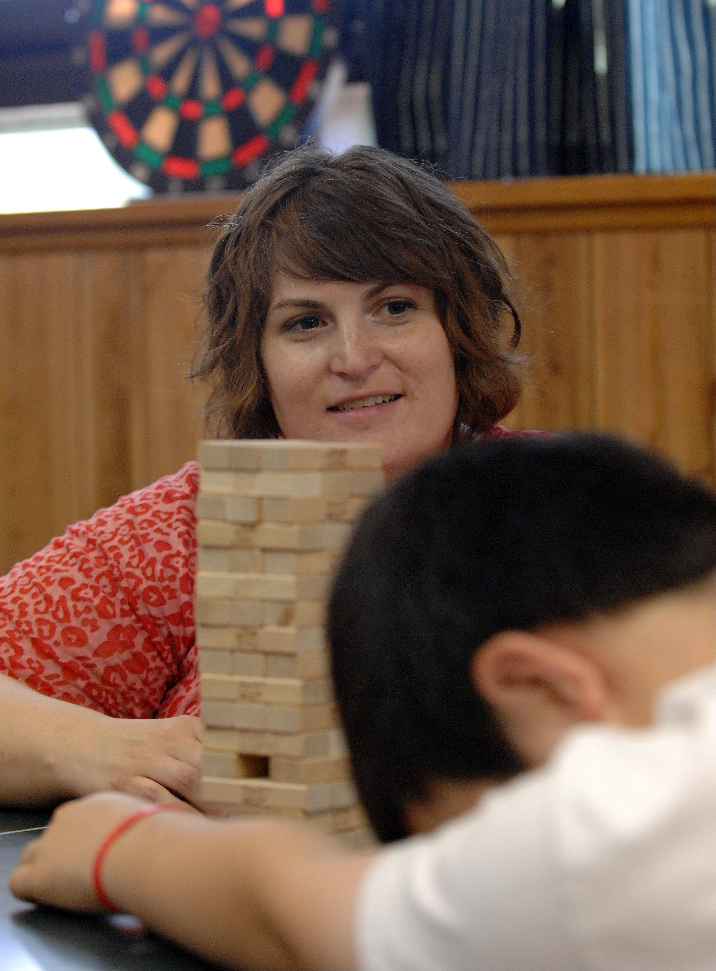 Erin Brumfield Grima plays a game of Jenga with a client with a twist. To help with self esteem, every time someone pulls out a piece, they have to list one of their positive attributes.